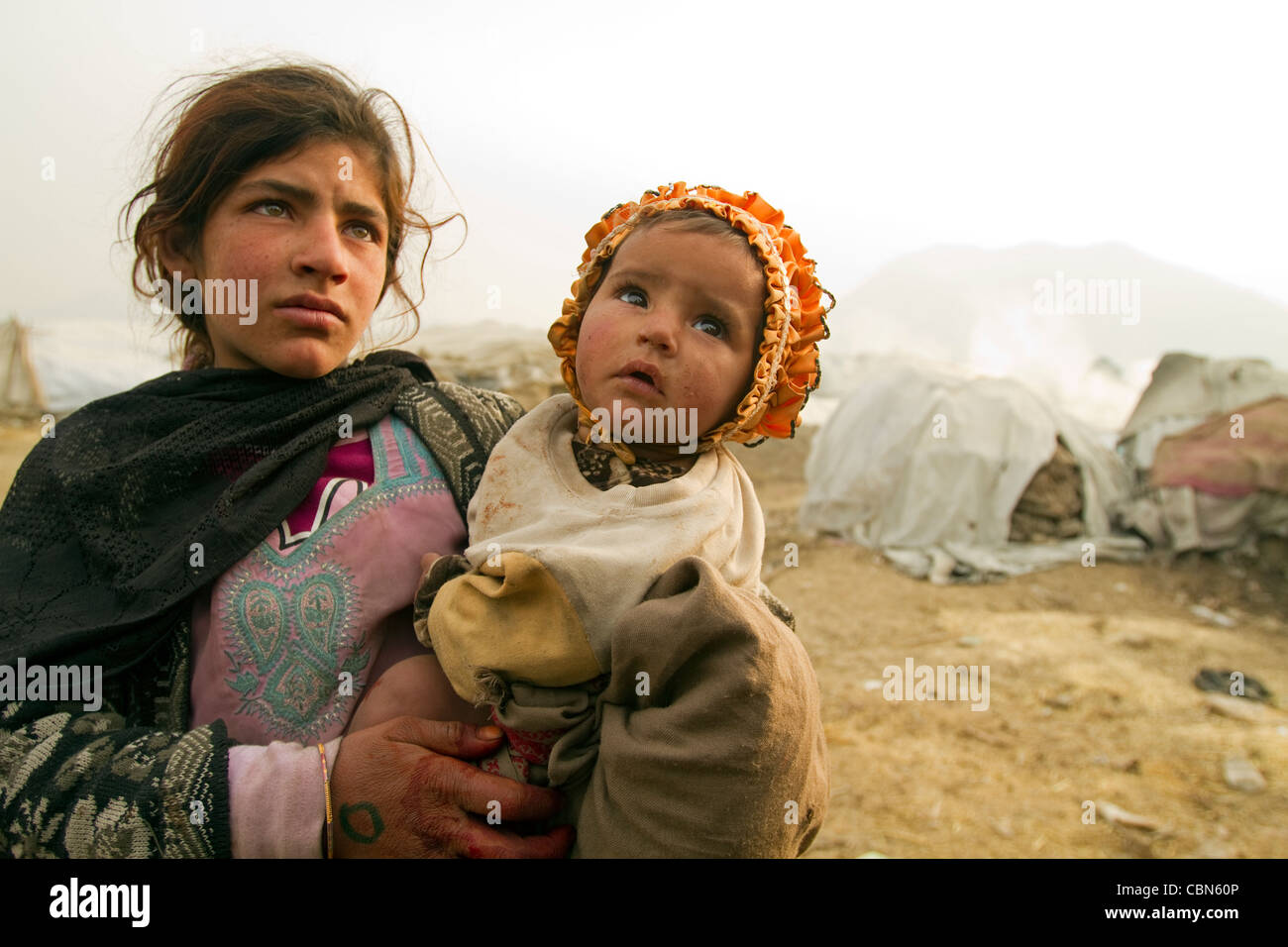 Portrait of young Afghan mother and baby living in poor conditions Kabul Afghanistan - Stock Image