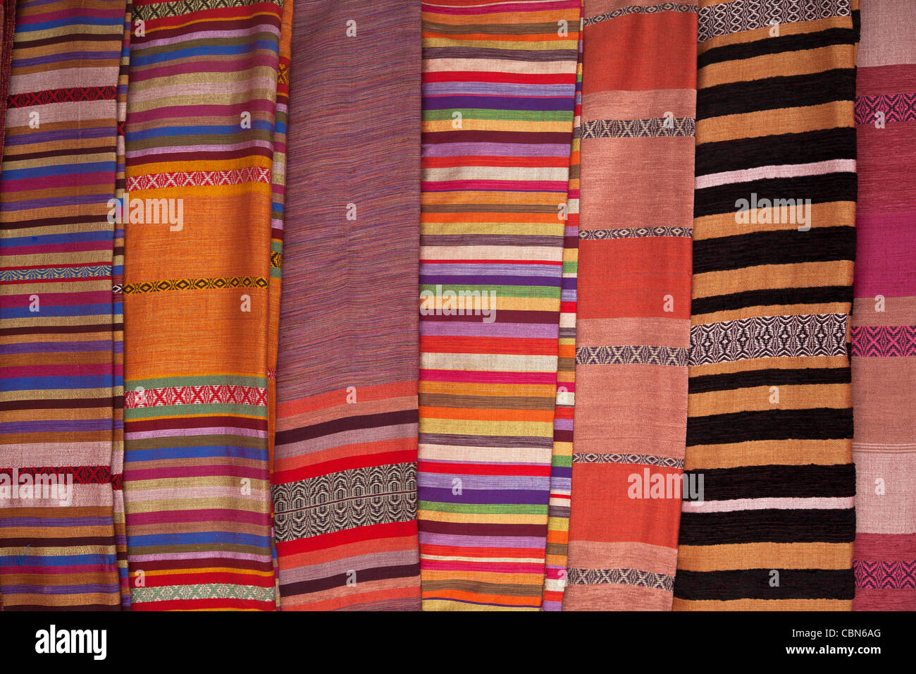 Colourful carpets on display in Marrakesh - Stock Image