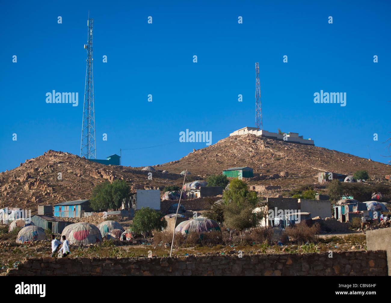Antennas On Top Of Hills And Slum Huts Village Down Boorama Somaliland Stock Photo