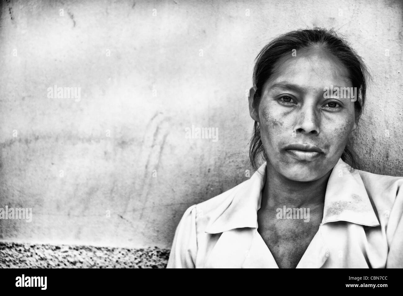 Close up of local woman with colorful wall in Copan Ruinas Honduras downtown city action Stock Photo