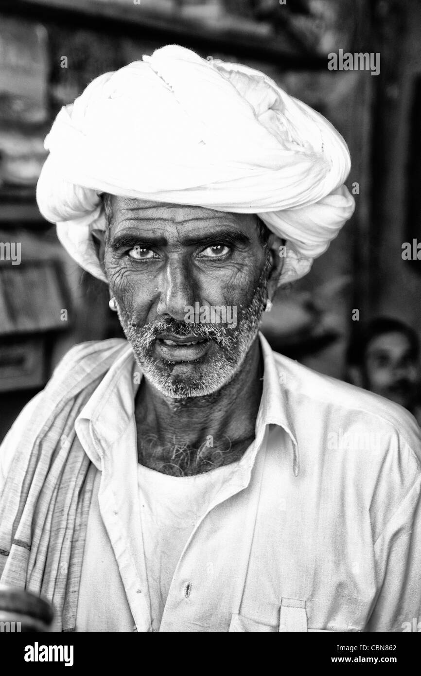 Traditional Hindu vendor man with white turban portrait in Jaipur Rajasthan  India - Stock Image ad6535725b6