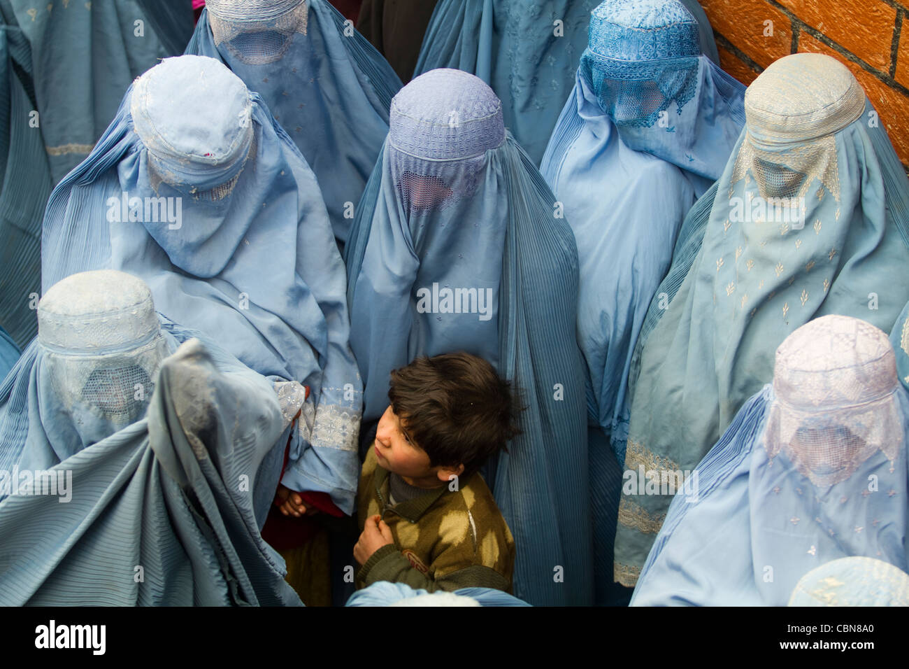 Women in burqa waiting aid for Feast of Sacrifice Kabul Afghanistan - Stock Image