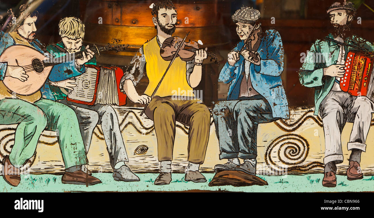 Painting of Irish musicians in window of De Barra's pub, Clonakilty, County Cork, Republic of Ireland. - Stock Image