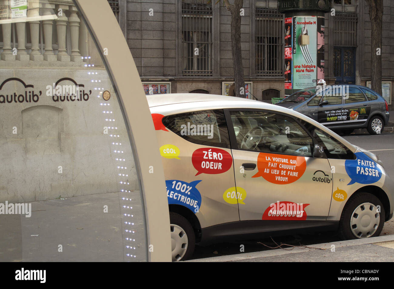 Autolib,electric car recharge at the base in the street,Paris,France - Stock Image