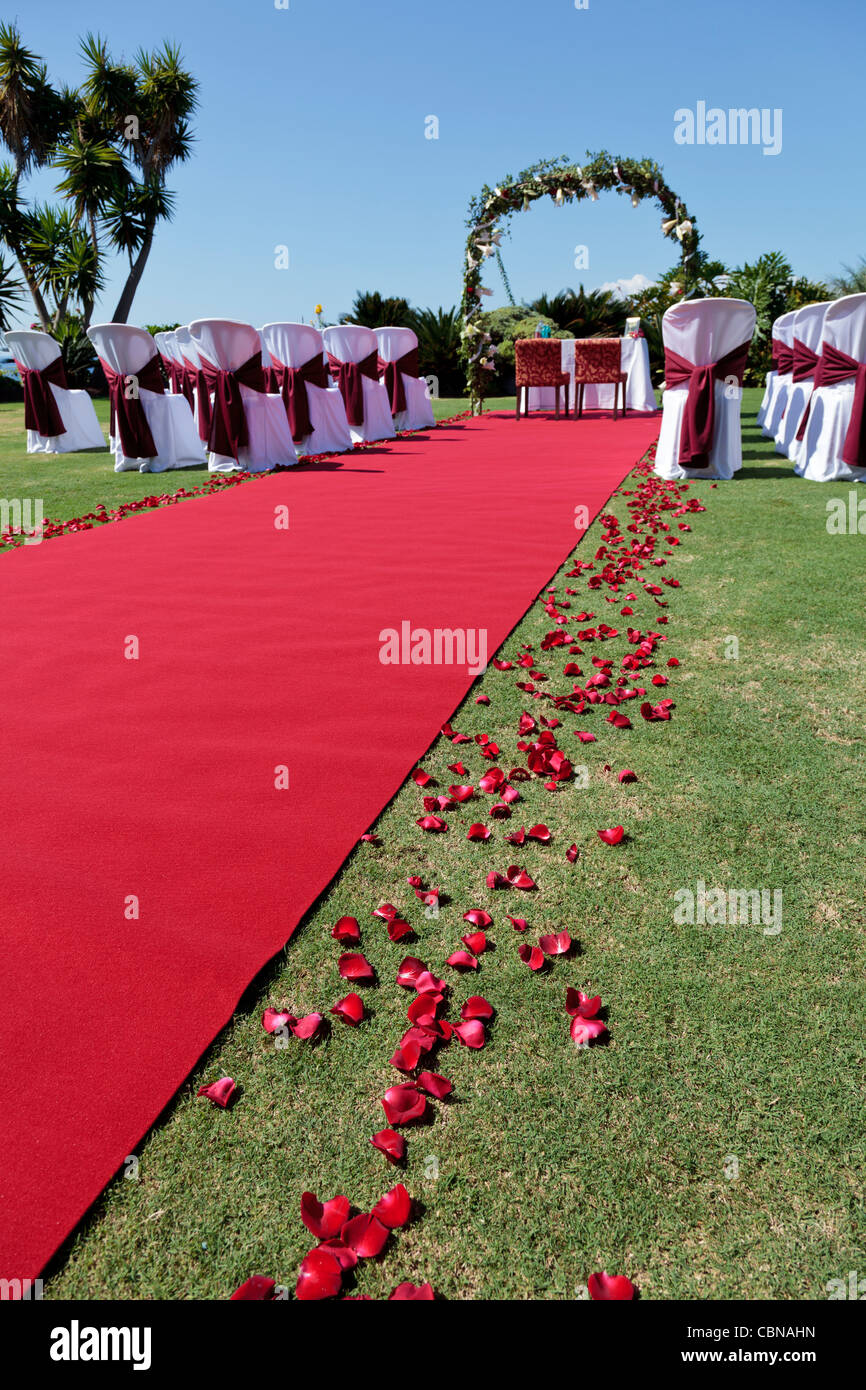 Outdoor Wedding Setting With Red Carpet Flower Petals White Covered
