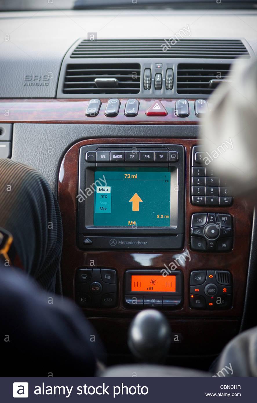 Car navigation system Maserati interior arrow point direction - Stock Image