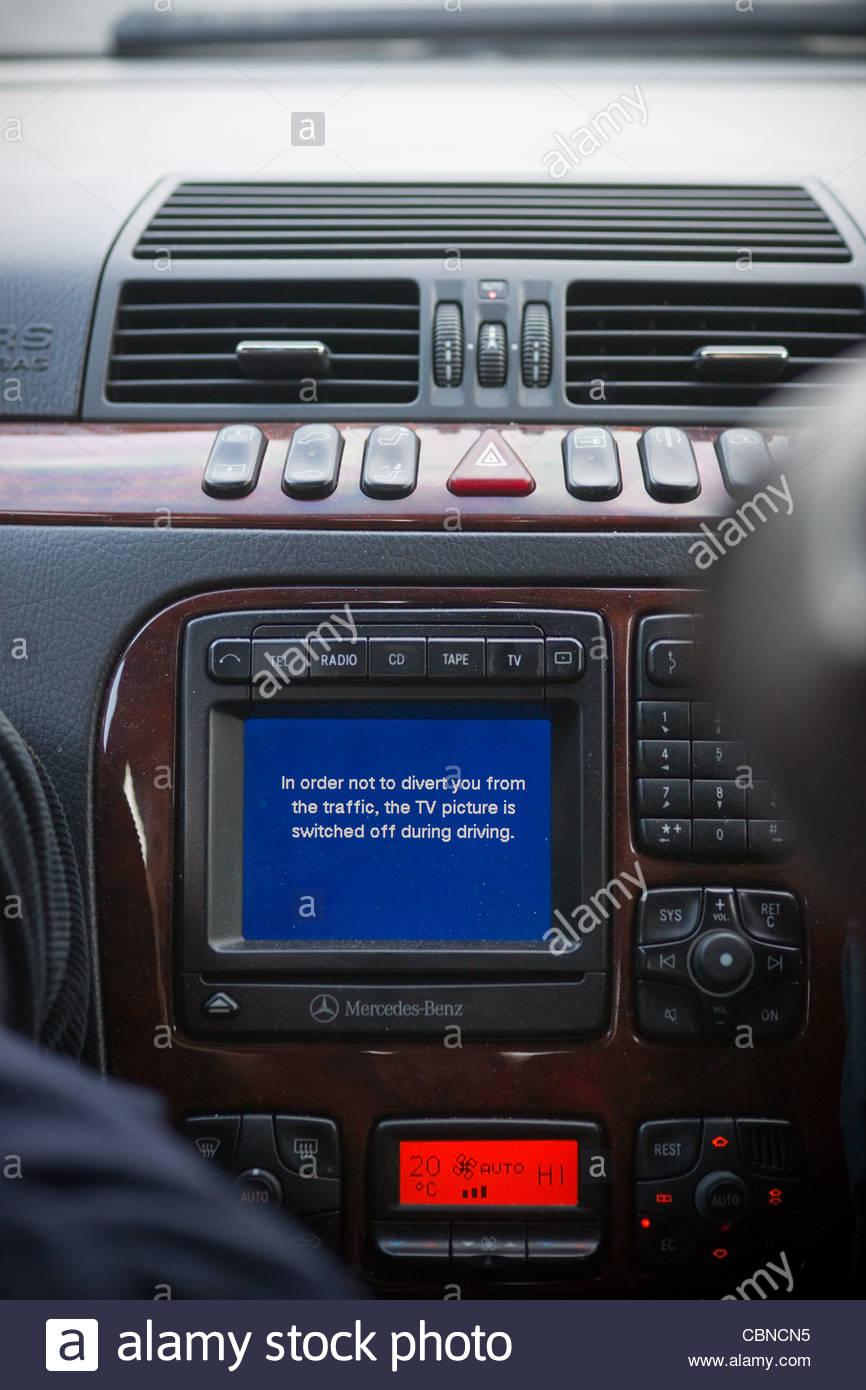 General street scene Central London car navigation system Maserati - Stock Image