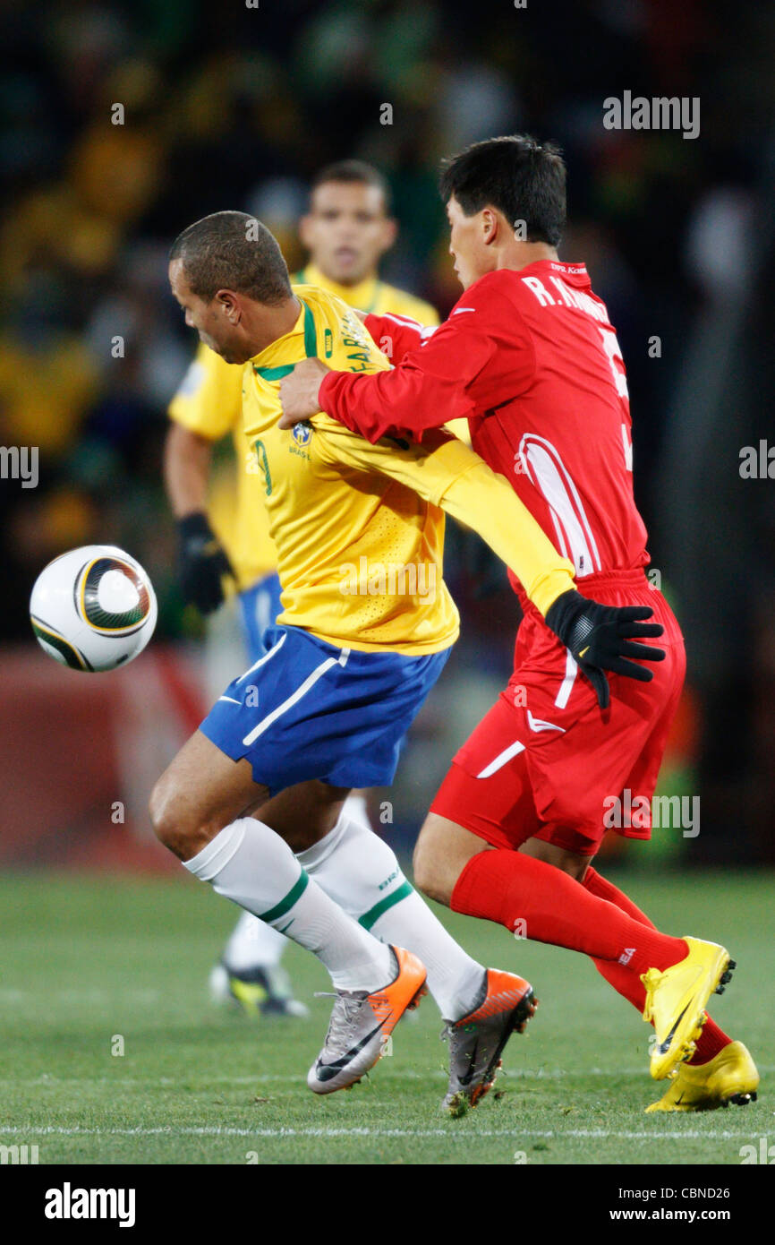 Kwang Chon Ri of North Korea (R) defends against Luis Fabiano of Brazil (L) during a FIFA World Cup match at Ellis - Stock Image