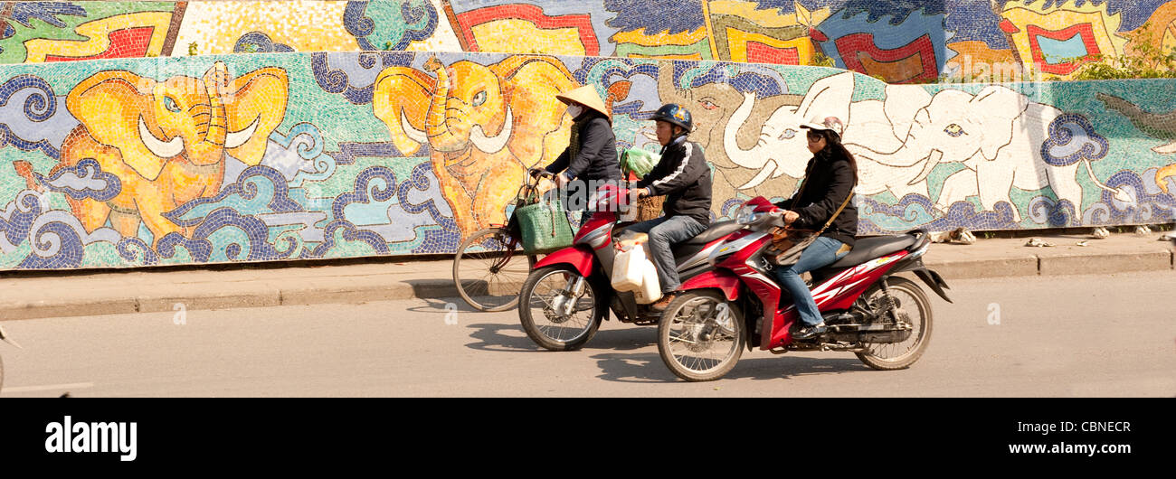 Ceramic Mosaic Mural  on dyke wall in Hanoi Vietnam - Stock Image