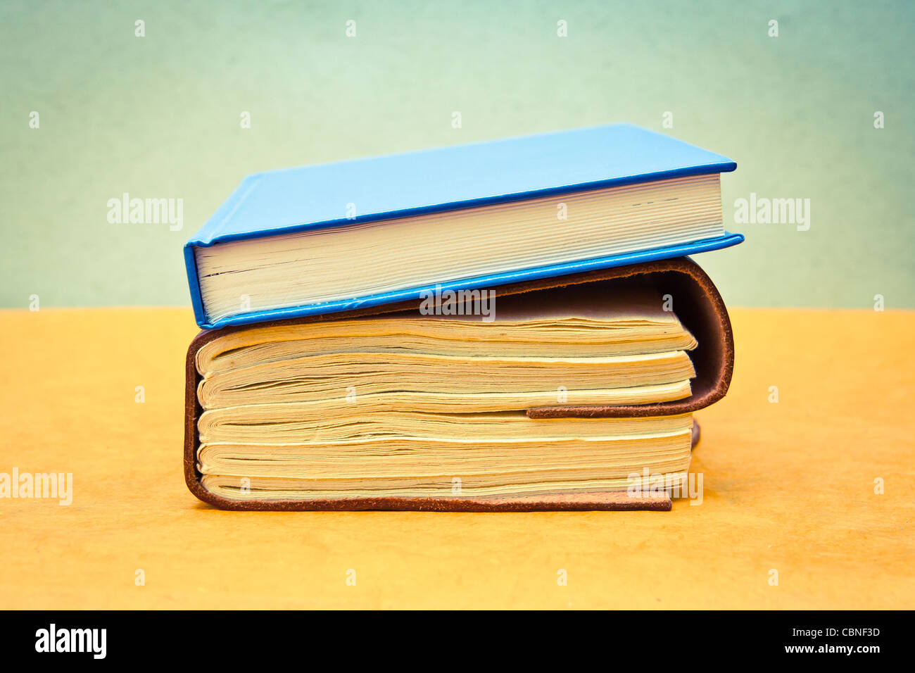 Two books in pastel tones as a still life image - Stock Image