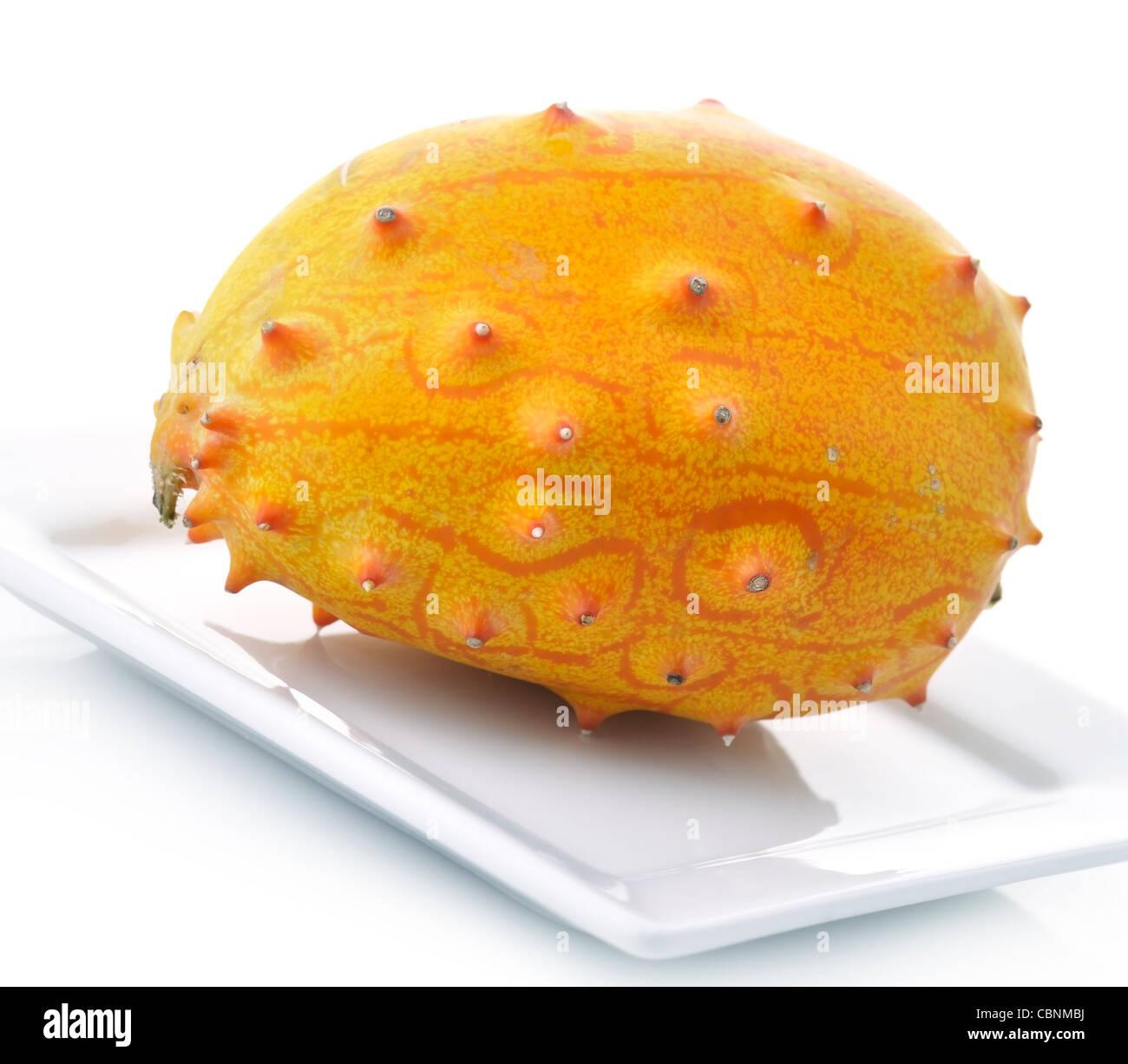 Kiwano Melon Tropical Fruit On A White Plate - Stock Image