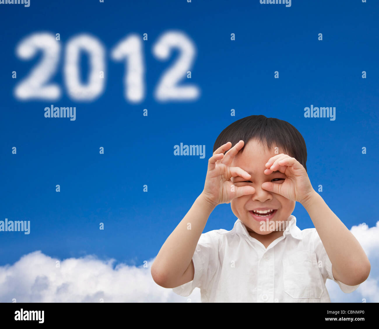 hand of happy kid make telescope shape and watching the cloud 2012 - Stock Image