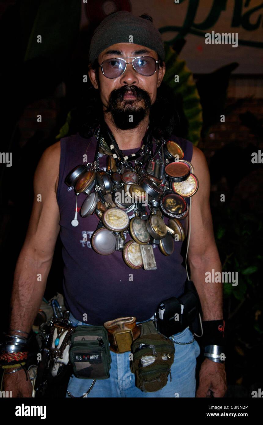 Carabao Roadie w/ Buddhist amulets (Thailand's best known Rock / Folk band), Bangkok, Thailand. credit: Kraig - Stock Image