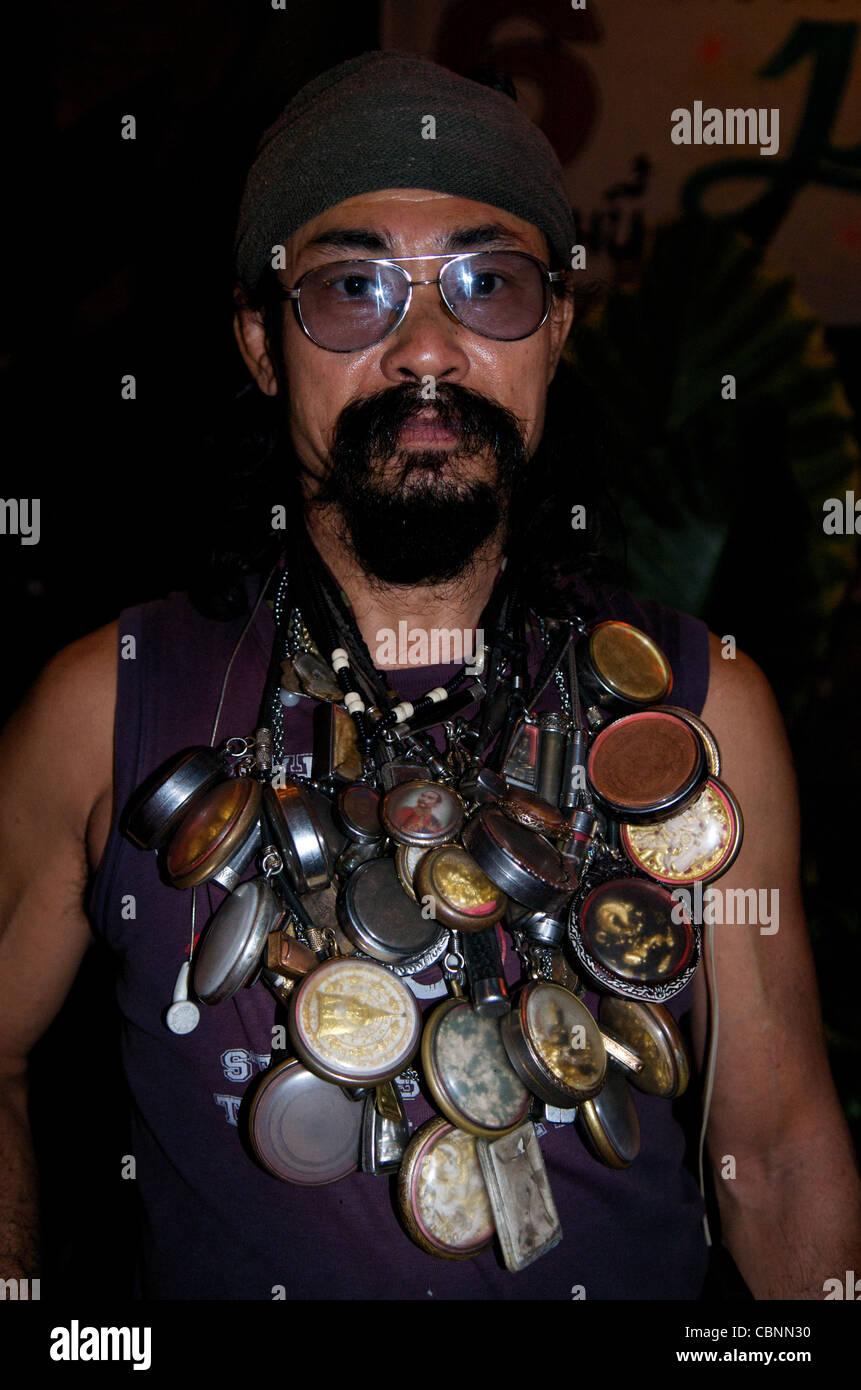 Carabao roadie w/ Buddha amulets (Thailand's best known folk / rock band), Bangkok, Thailand. credit: Kraig - Stock Image