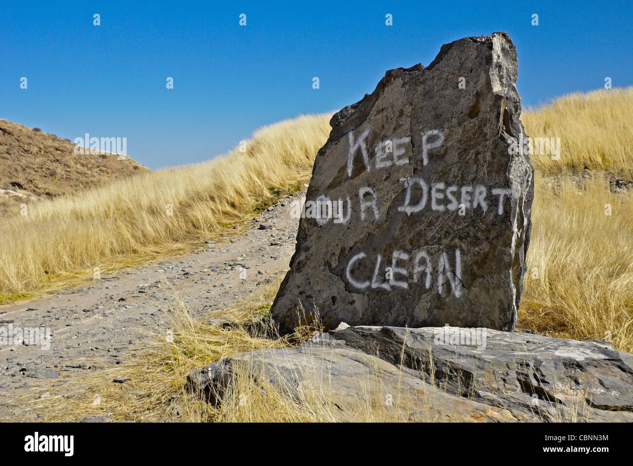 Anti-littering message painted on rock, Namibia - Stock Image