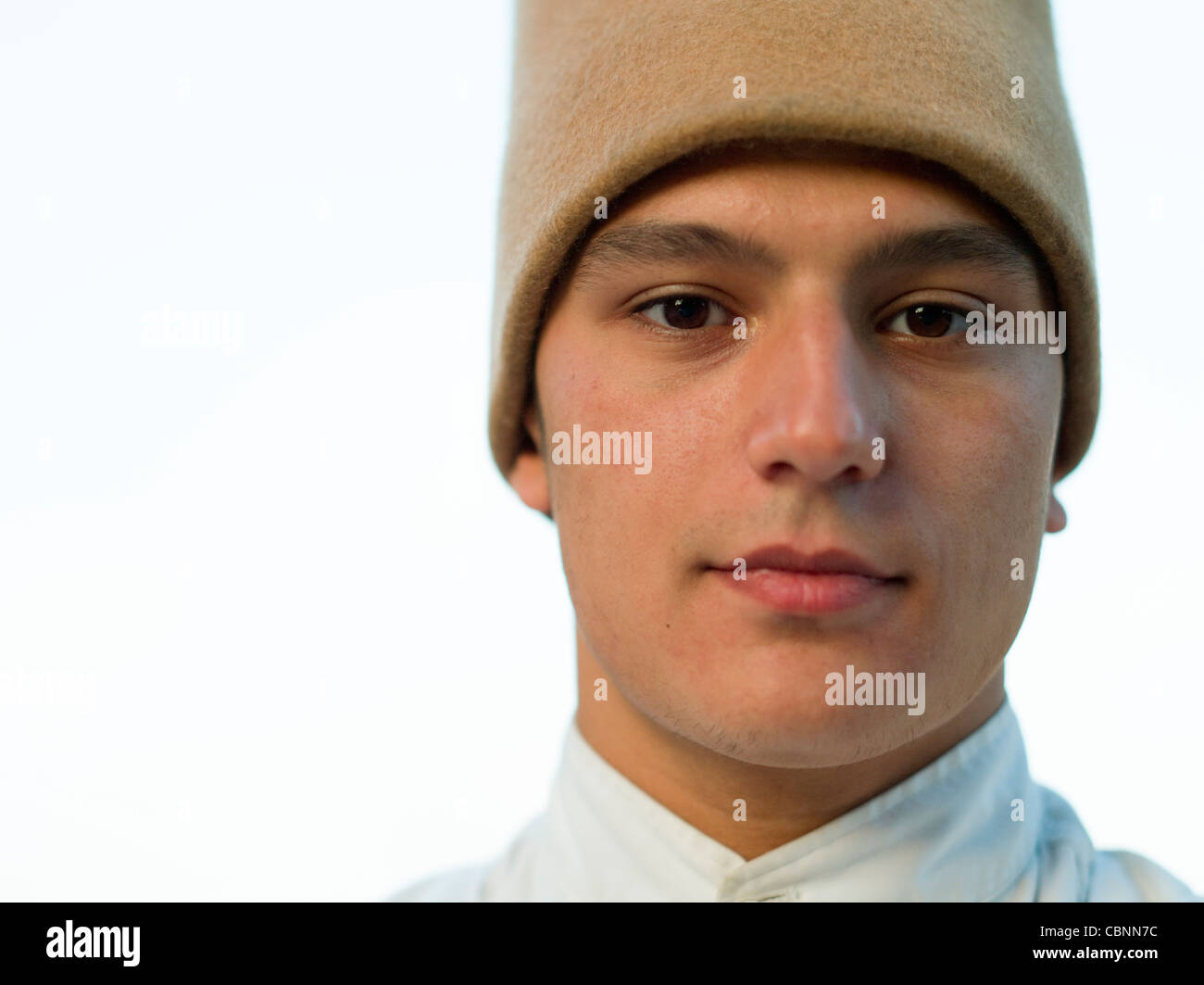Portrait of Sufi Whirling / Spinning Dancer wearing sikke felt hat Stock Photo