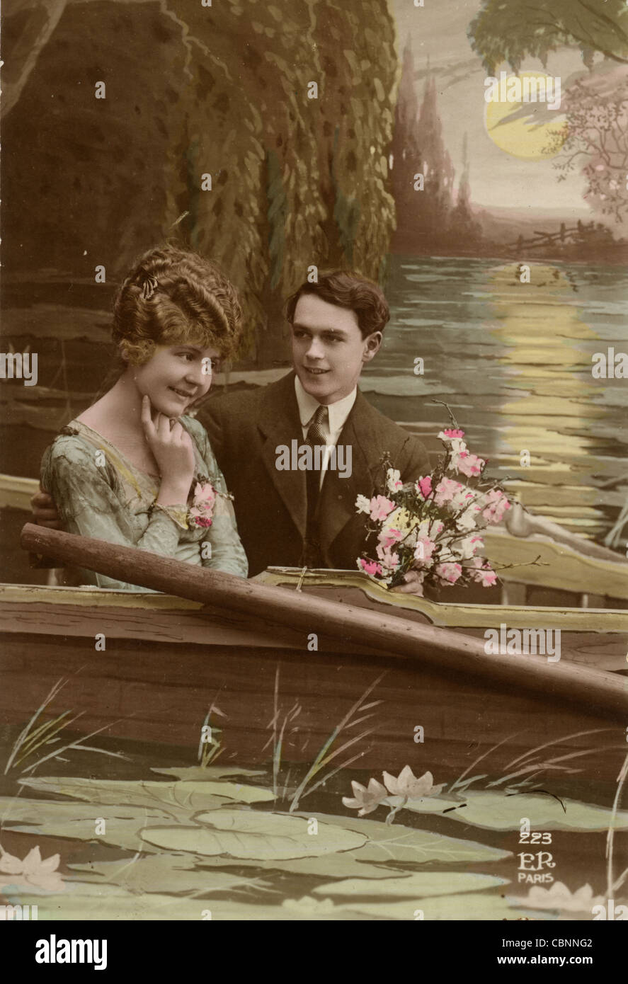 Lovers in Rowboat Pondering Question - Stock Image
