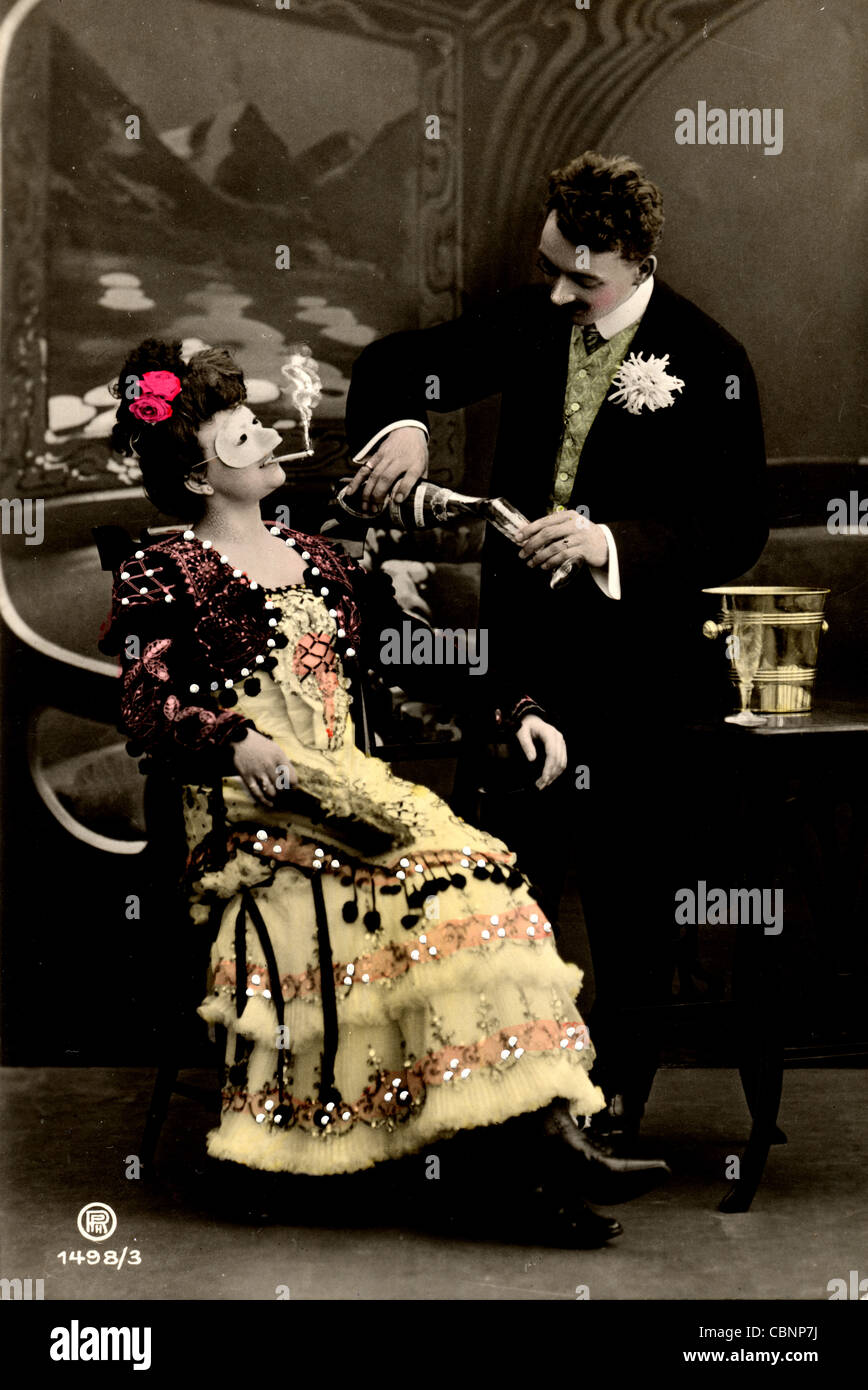 Dandy Pours Champagne for Masked Beauty - Stock Image