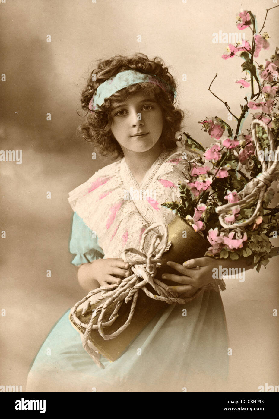 Little Girl with Large Flower Bouquet of Dogwood Blooms Stock Photo ...