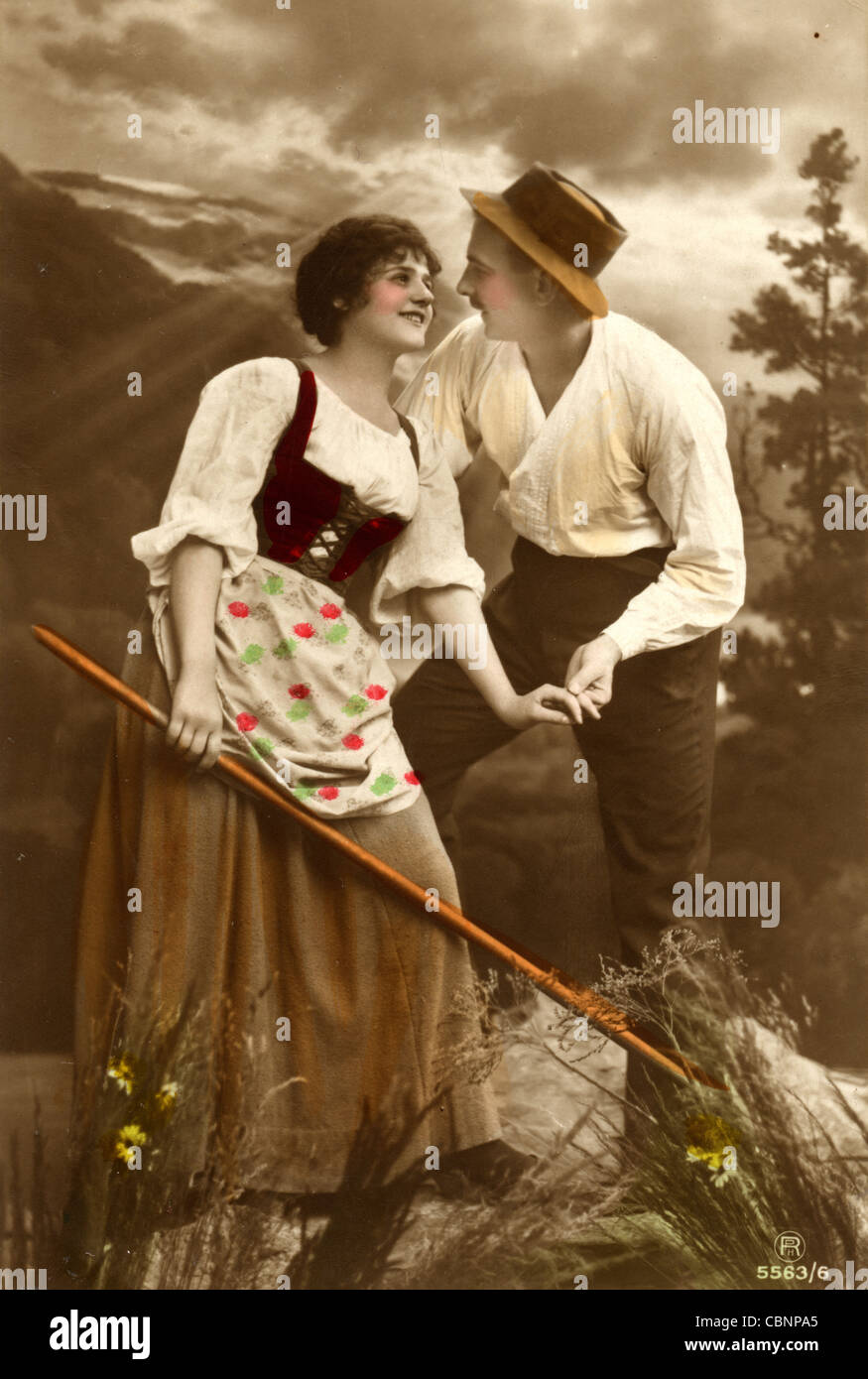 Attractive Young Peasant Couple in the Alps - Stock Image