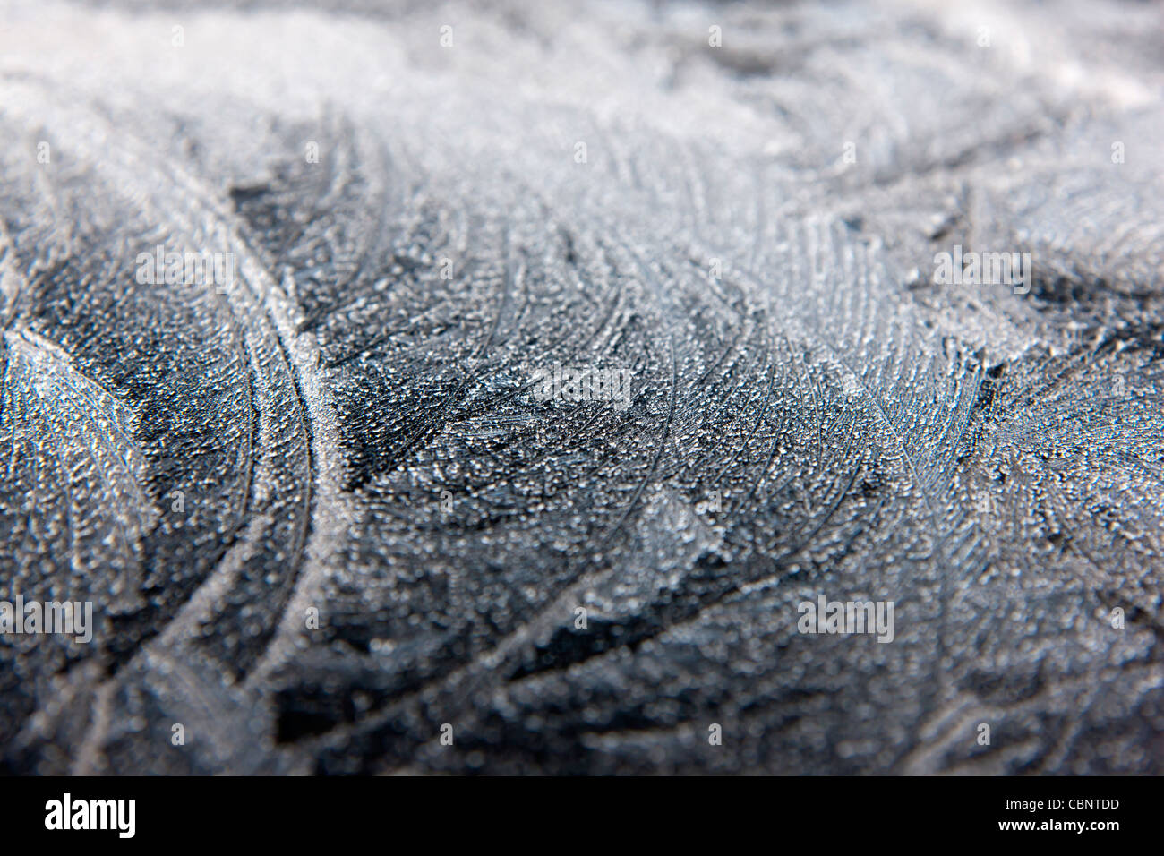 occurring crystalline inorganic solid Ice crystals Frost on a window pane frozen water transparent opaque - Stock Image