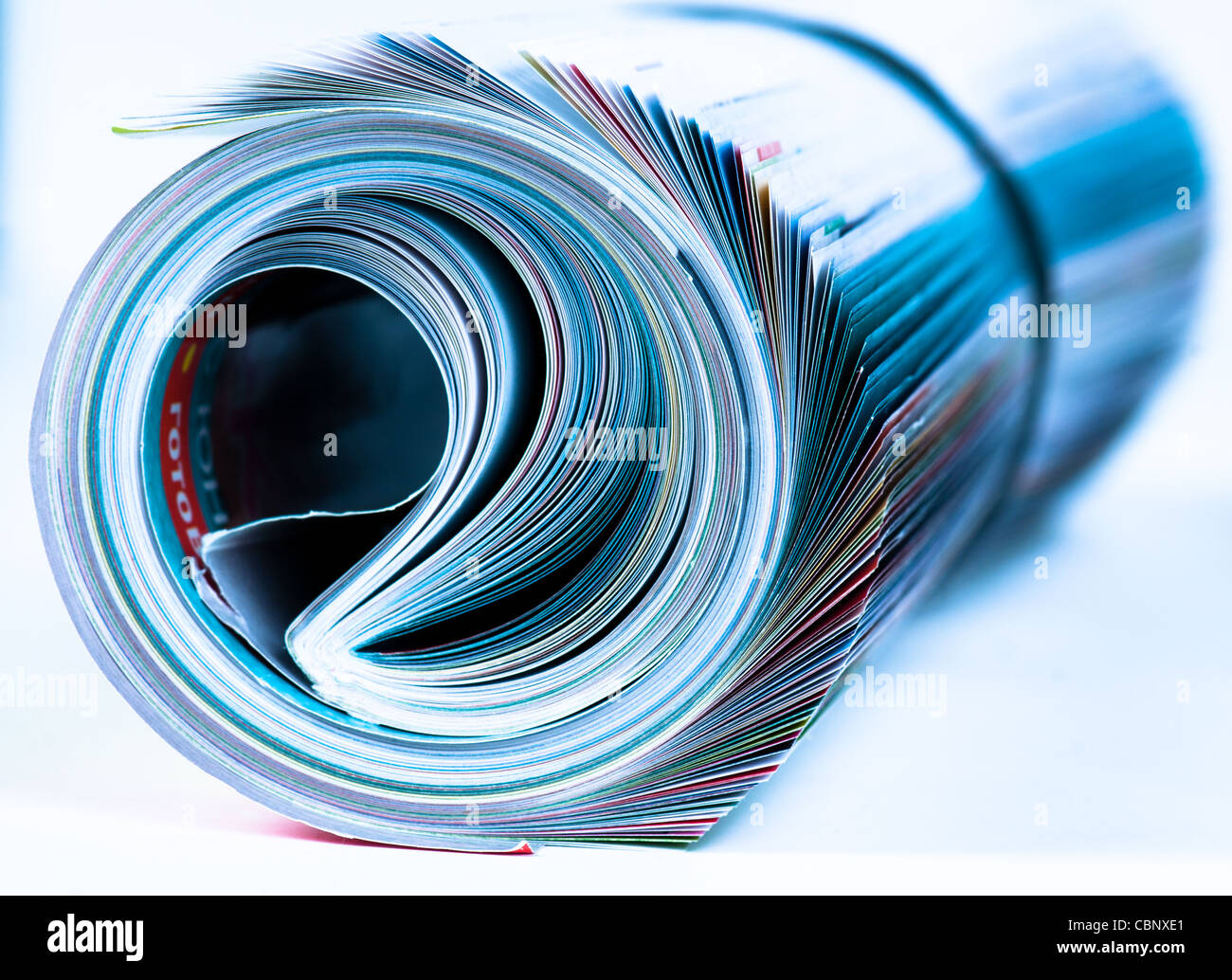 Magazine Roll. Side view. Blue toned Stock Photo
