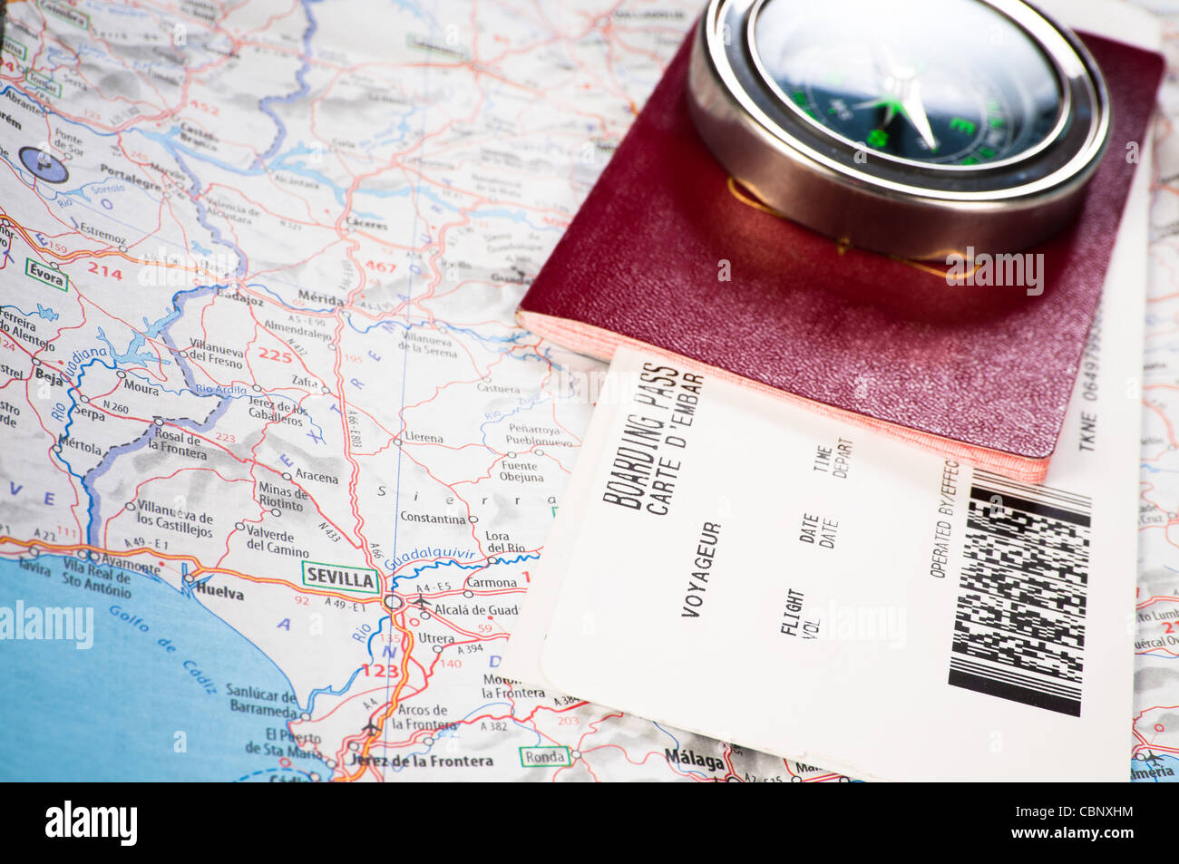 compass and passport with boarding pass - Stock Image