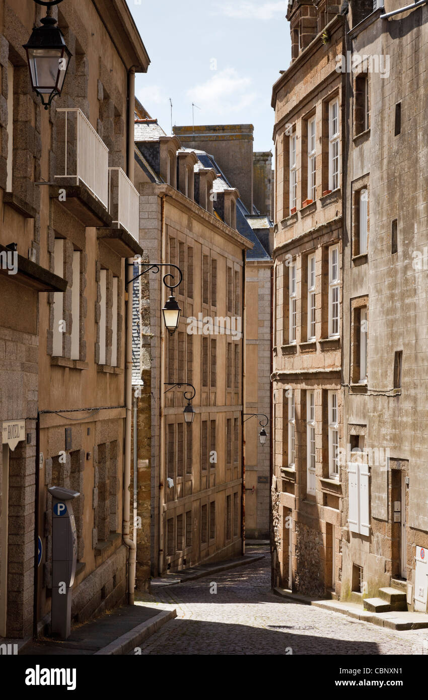 Old narrow street in St Malo, Brittany, France - Stock Image