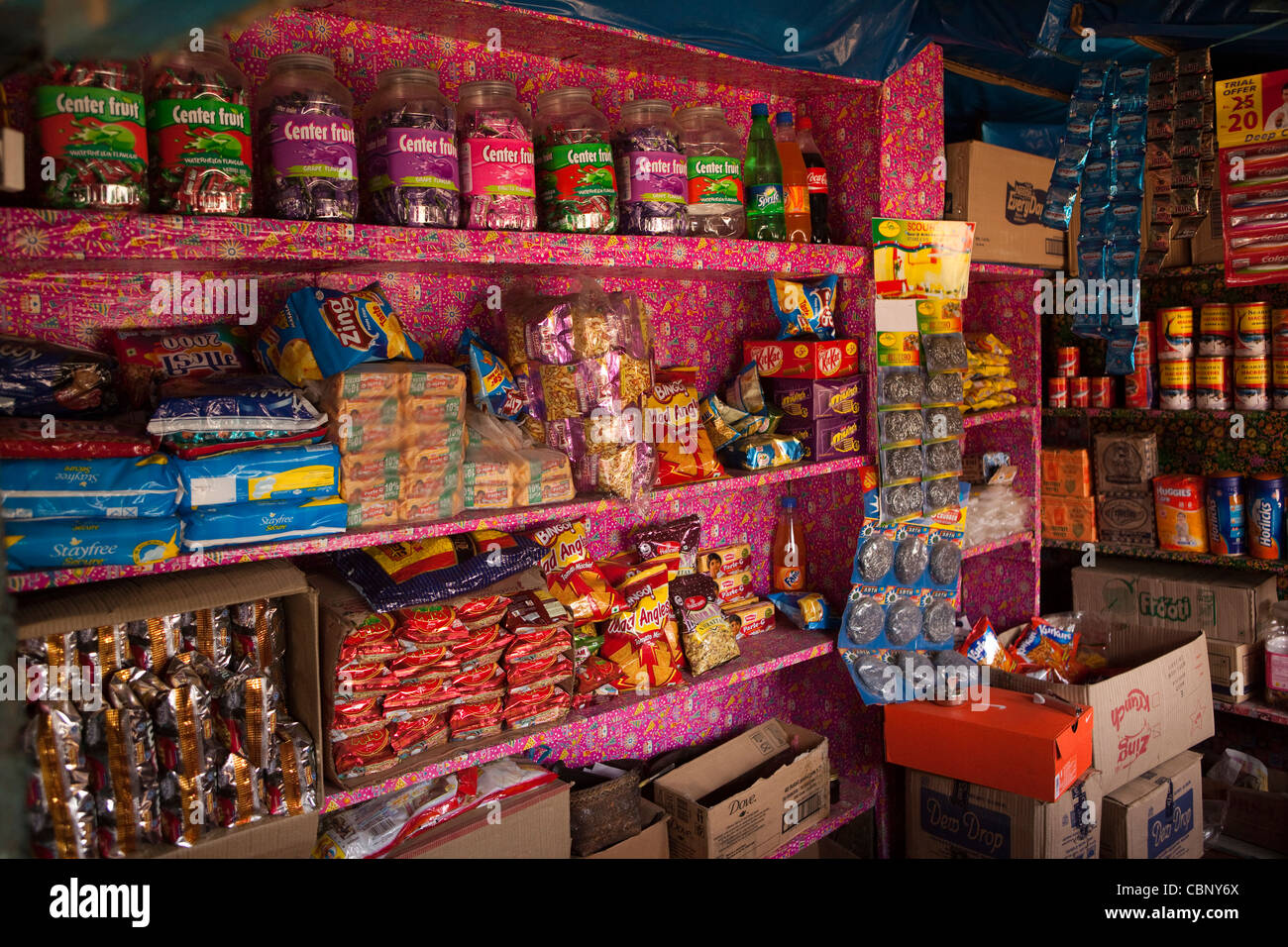 India, Manipur, Lairouching Hills, shelves of small shop in small local bazaar - Stock Image