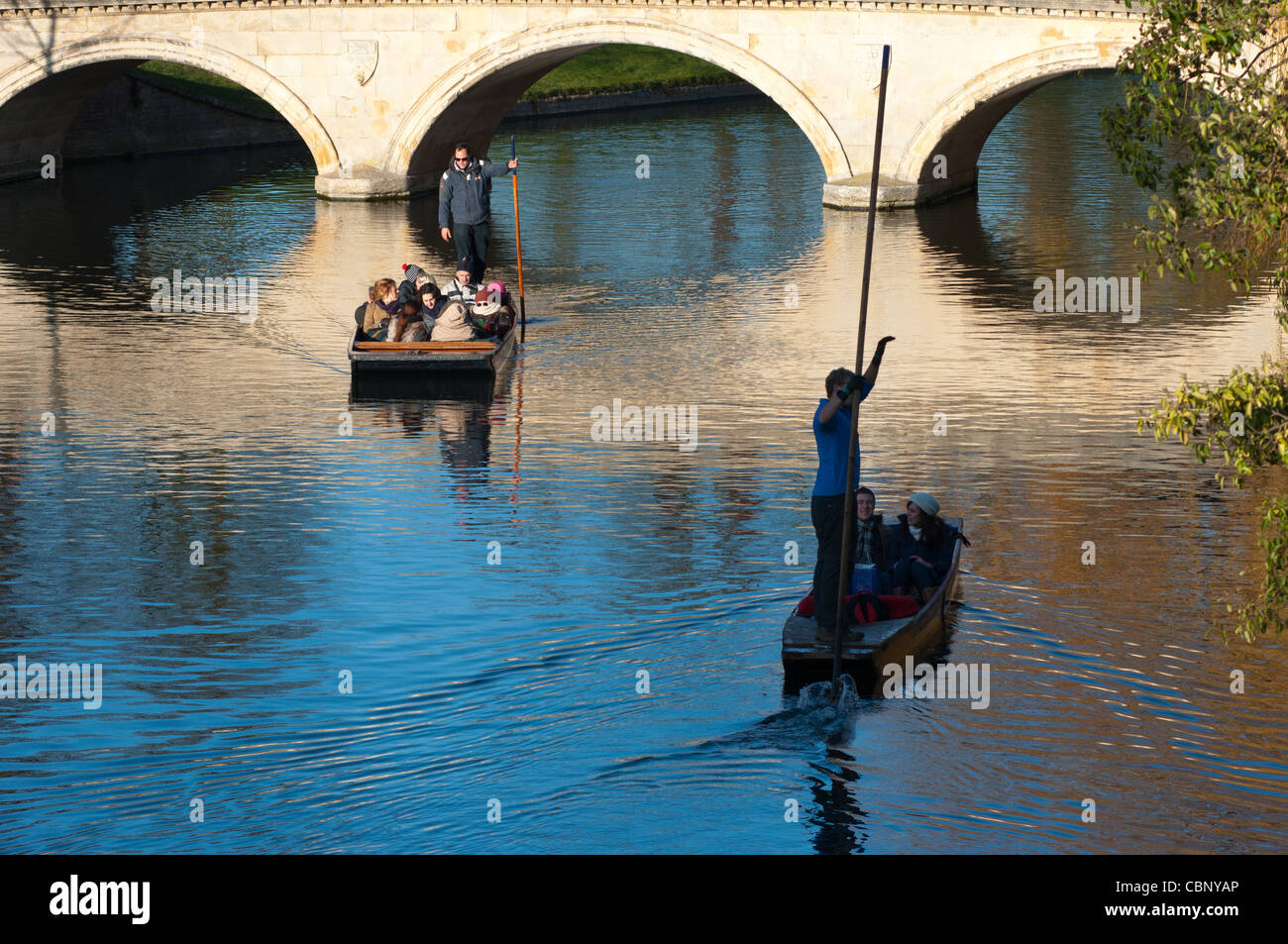 Punting silhouette on river Cam, Cambridge England. - Stock Image