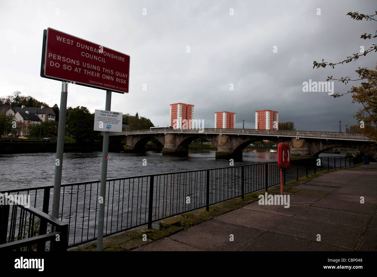 Dumbarton, Scotland lies at the junction of the River Leven and the Clyde, tower blocks past the bridge - Stock Image