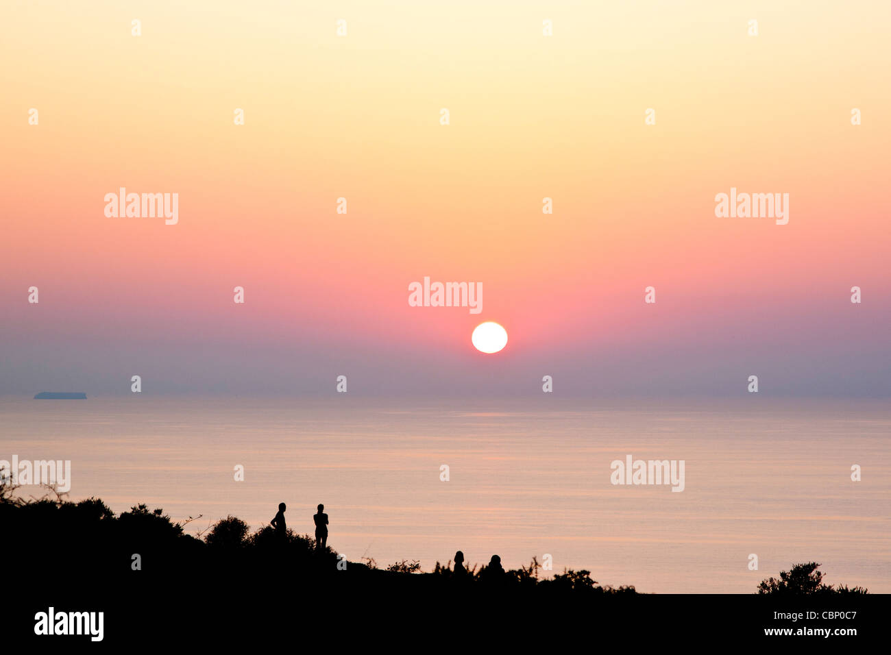 any People Silouettes on Sunset in Lampedusa - Stock Image