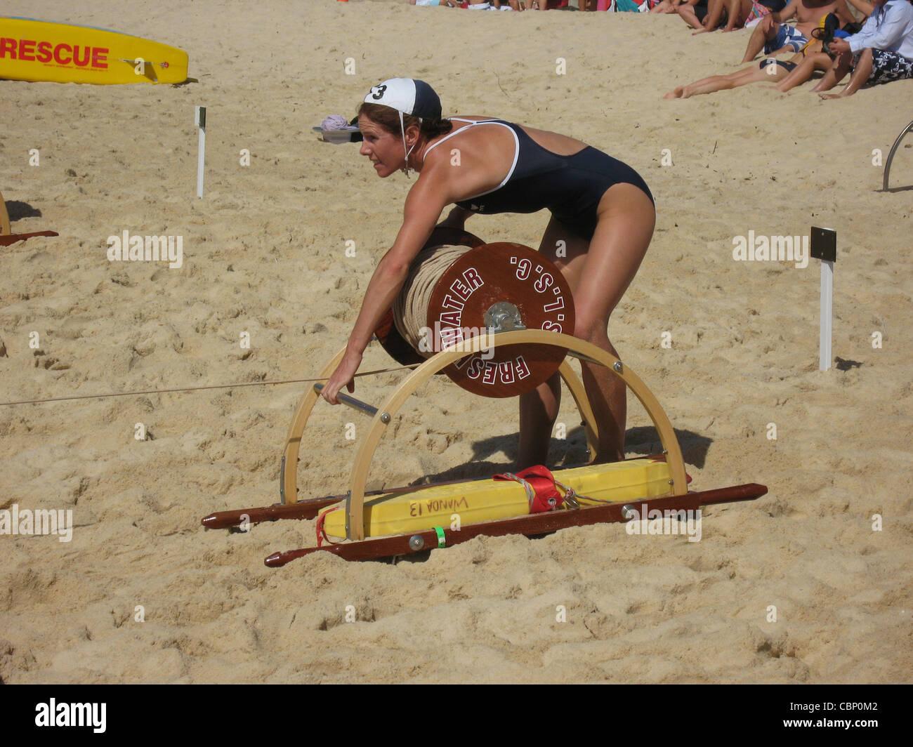 Female Lifeguard Performs Surf Rescue Drill On Bondi Beach Australia Stock Photo Alamy