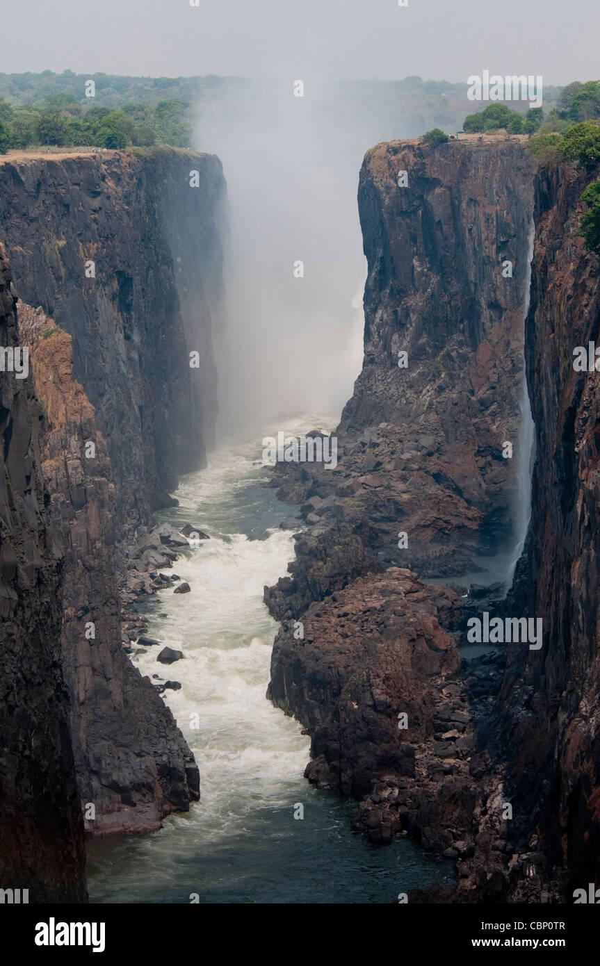 Africa Zambia-Victoria Falls from Zambia side-Zimbabwe is on the left side. Zambezi River is below - Stock Image