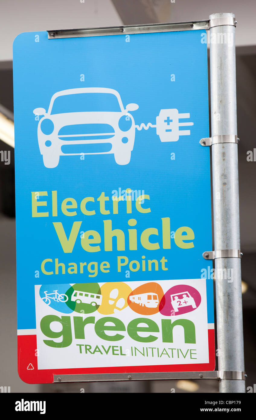 An electric car charging point provided free of charge in a Tesco Supermarket car park for their customers, near Stock Photo
