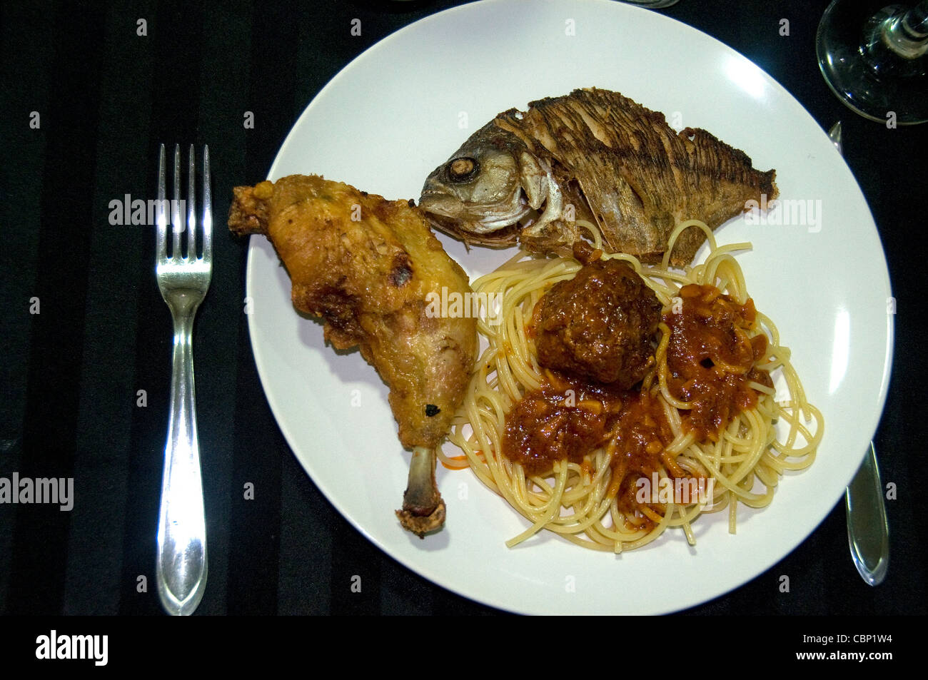 An Amazon River luxury fishing and ecotour yacht operation serves a variety of meats for dinner including piranha - Stock Image
