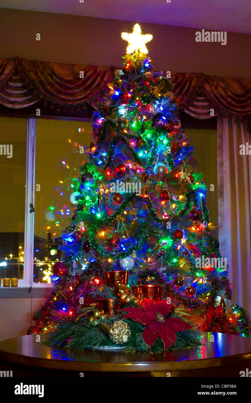 Decorated Christmas Tree With The Star Beside The Window Stock Photo
