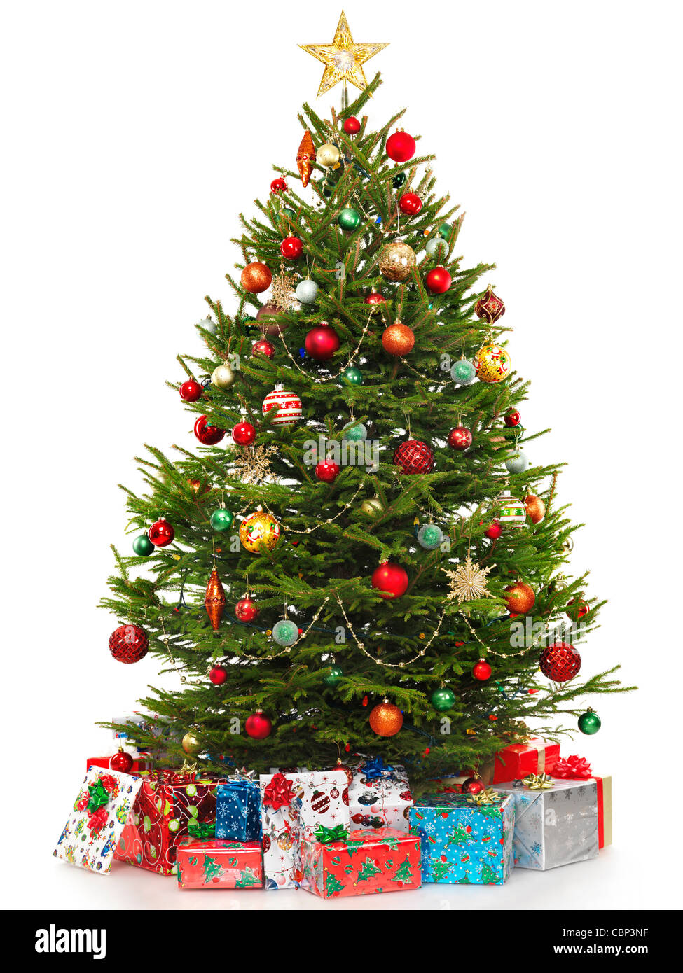 Beautiful decorated Christmas tree with colorful wrapped gifts under it. Isolated on white background. - Stock Image