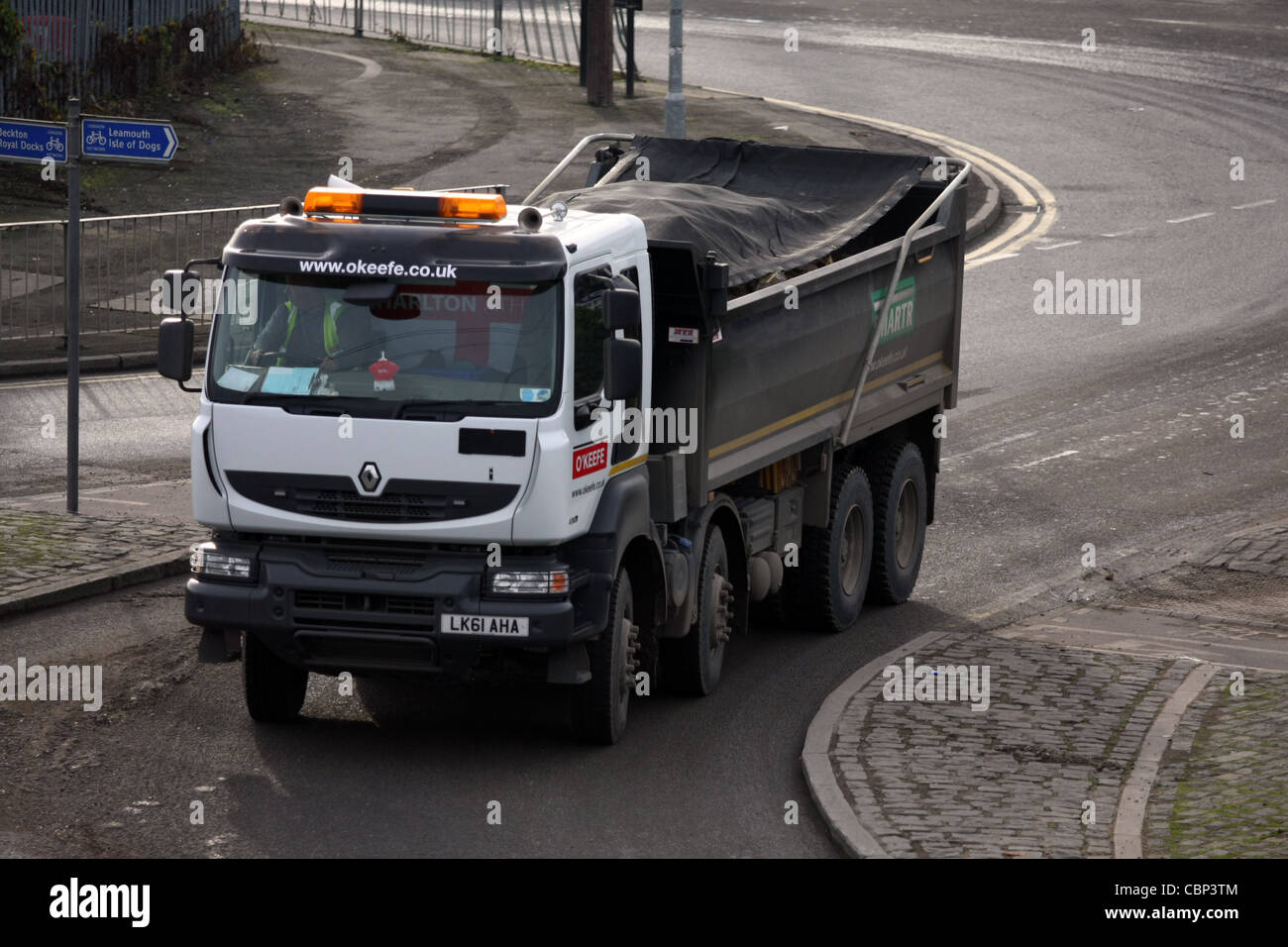 a truck entering a roundabout in London, England - Stock Image
