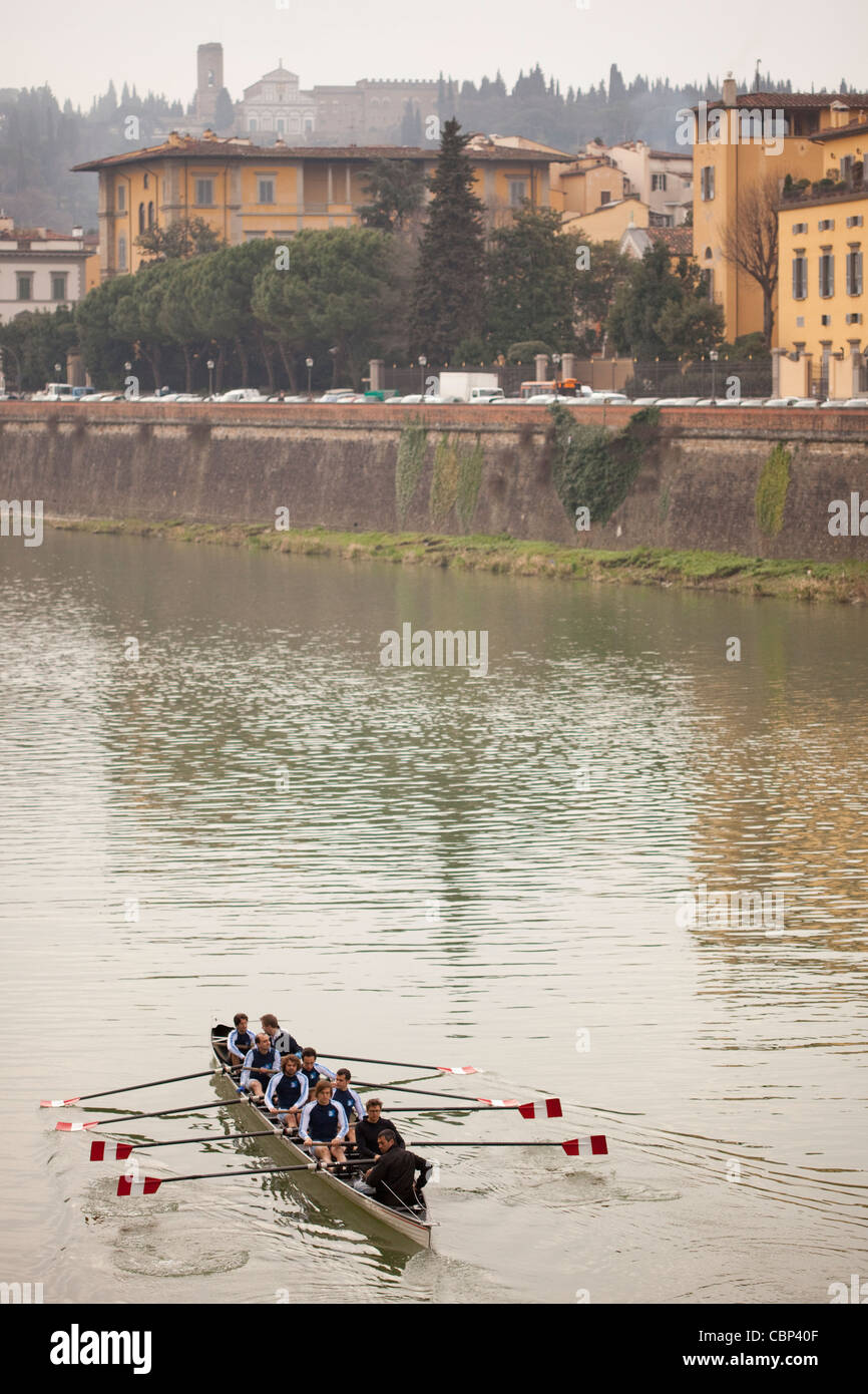 Rowing team practicing in the Arno River, Florence, Italy - Stock Image