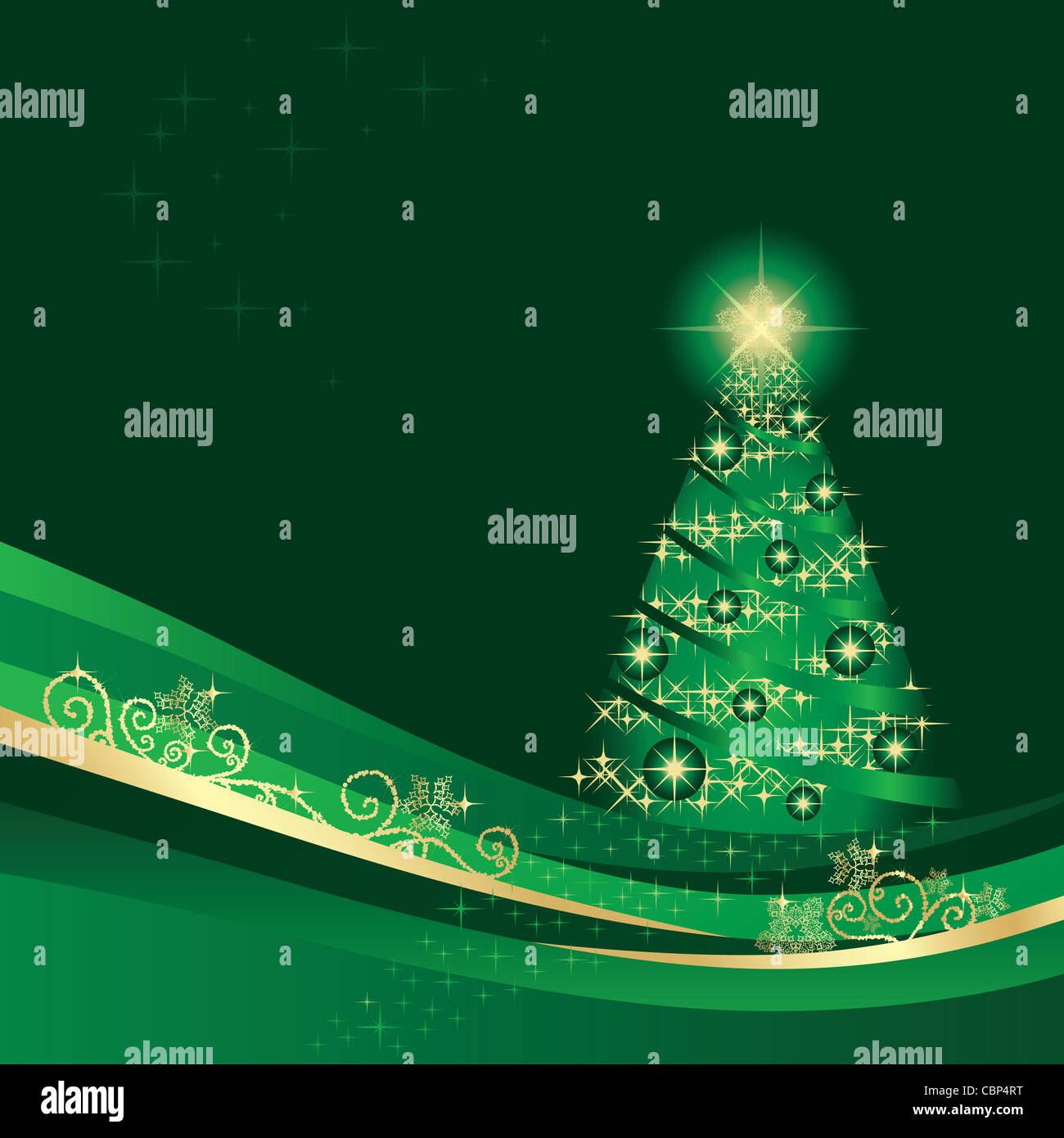 Glowing green and gold Christmas tree in a green winter garden Stock Photo
