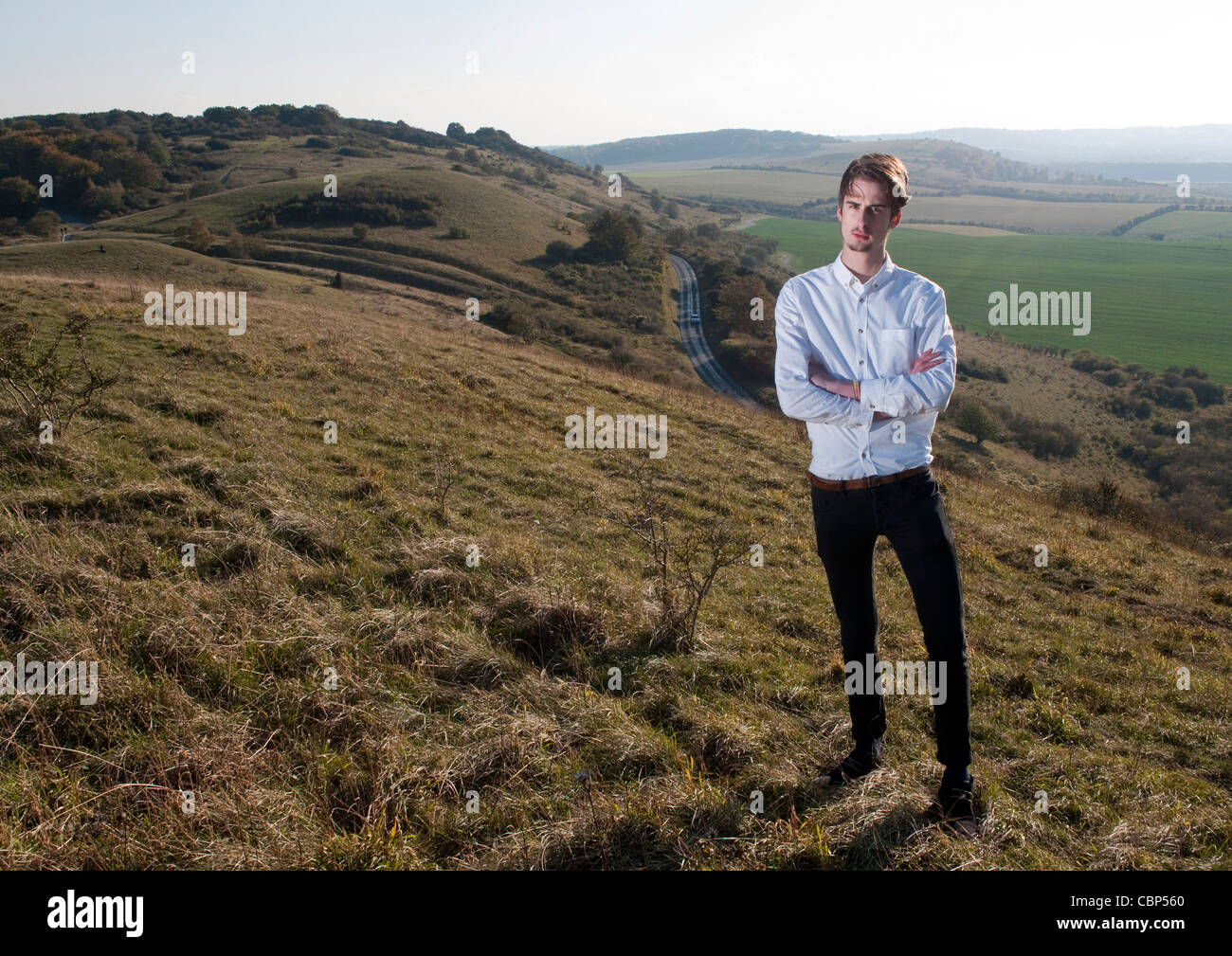 Portrait of a businessman with a countryside backdrop. Stock Photo