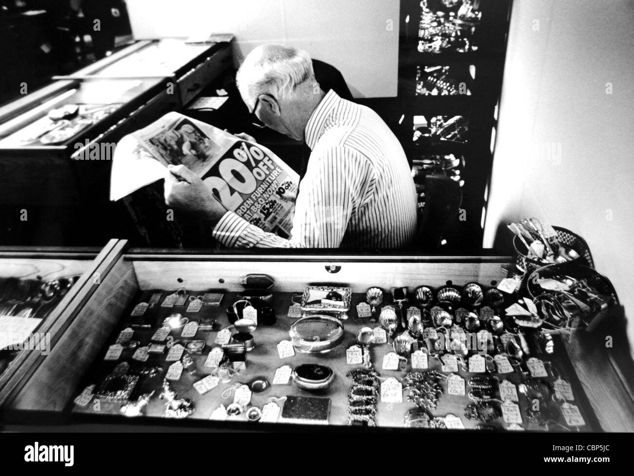 Time to hunt the newspaper ads for a bargain at the Antiques Fair Brighton 1991 - Stock Image