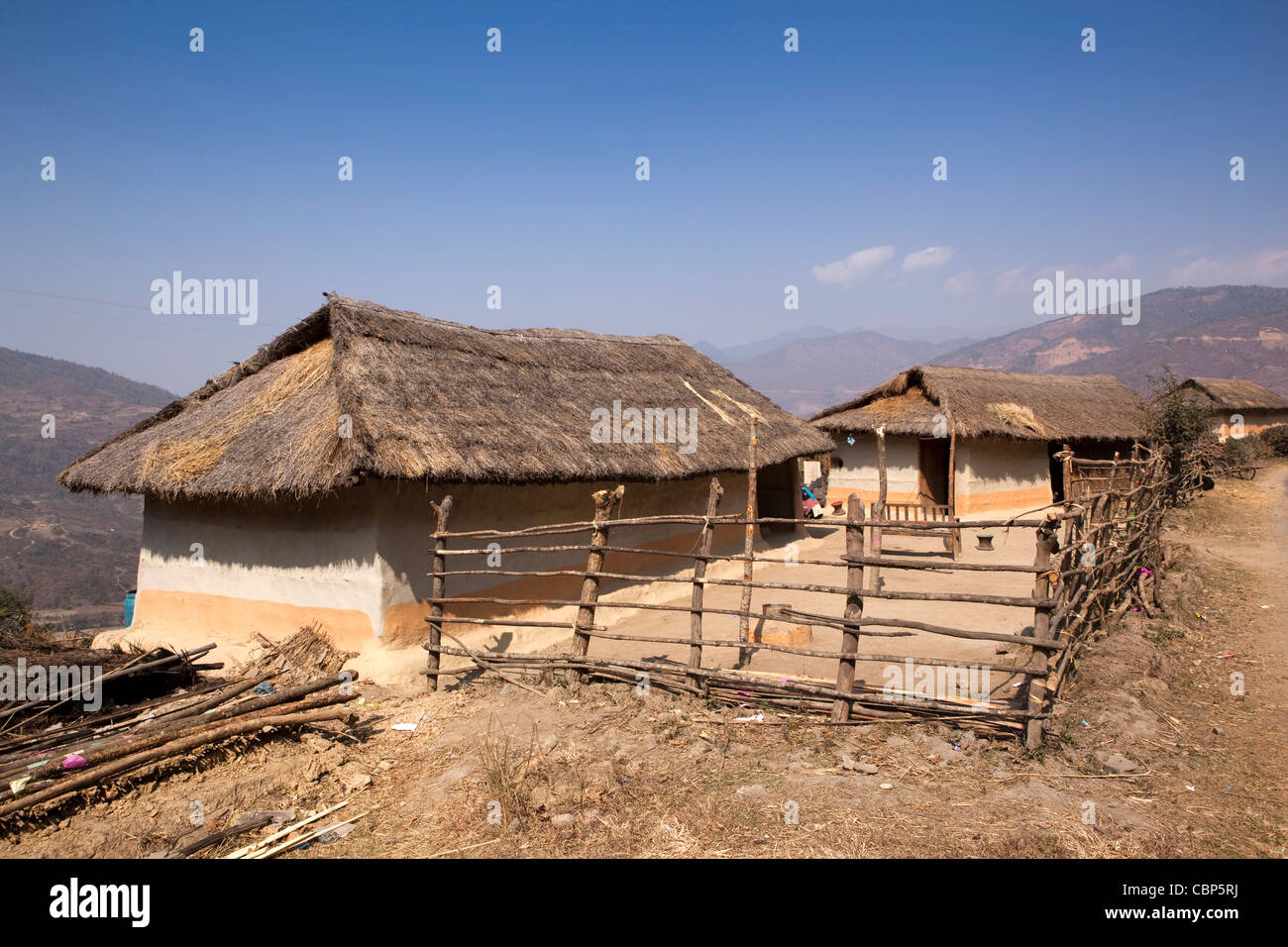 India, Manipur, Lairouching Hills, local wooden built, dung rendered house and compound - Stock Image