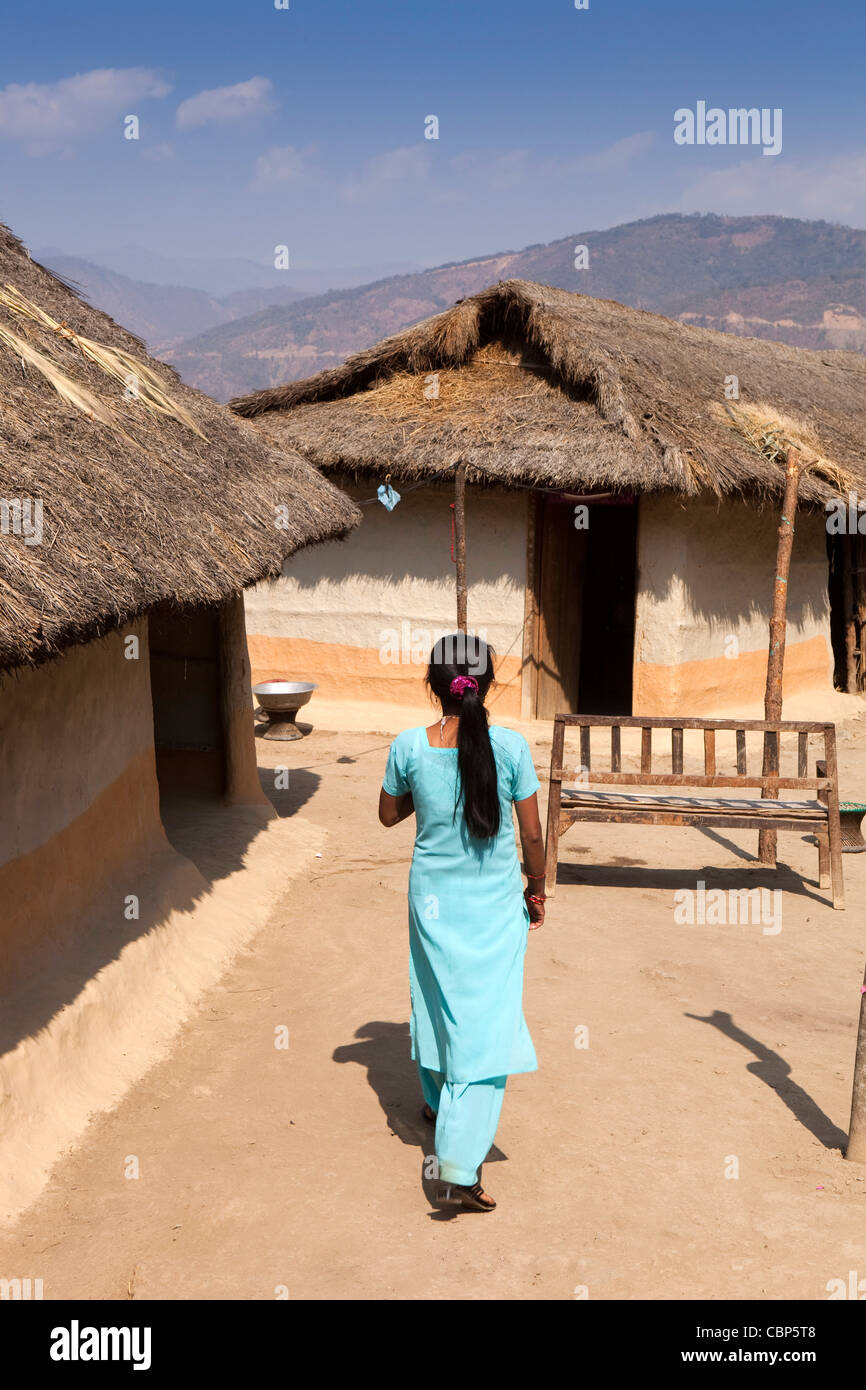 India, Manipur, Lairouching Hills, woman in compound of local wooden built, dung rendered house - Stock Image