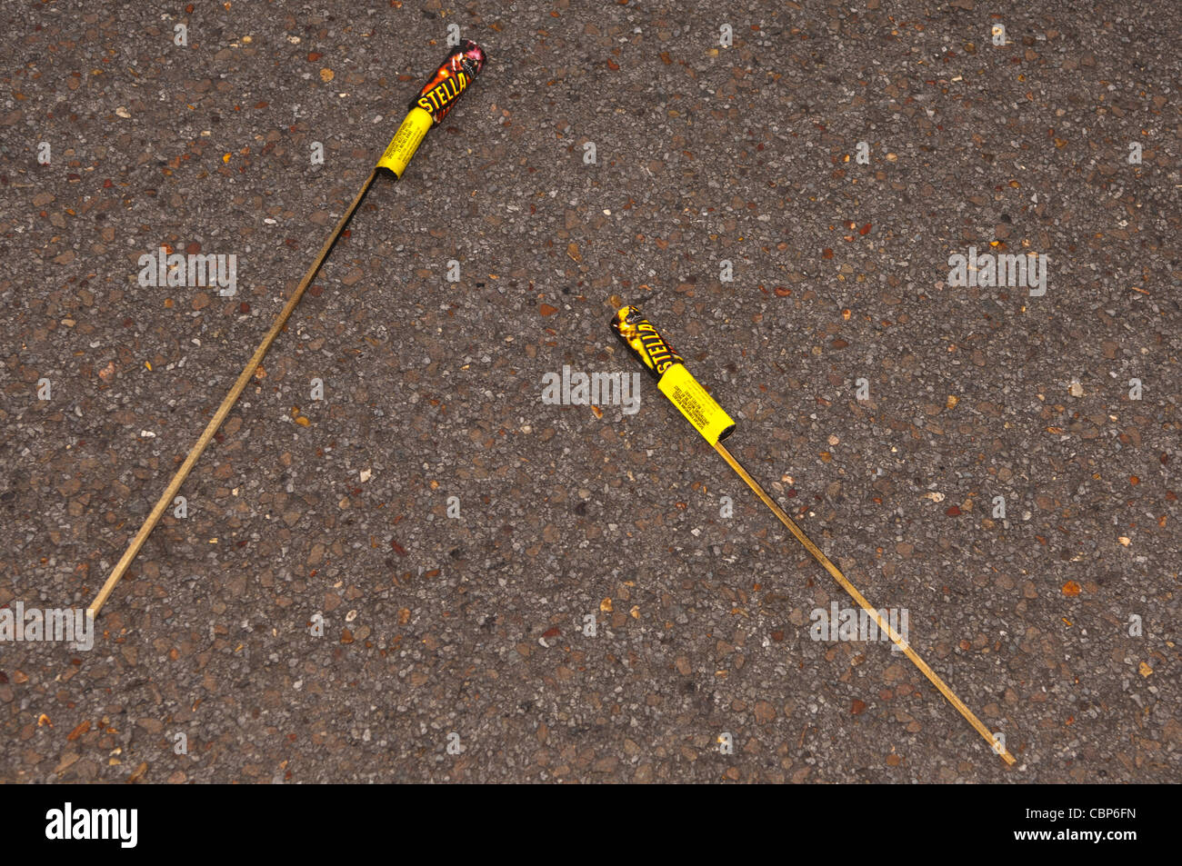 Used fireworks rockets found on the road after fireworks night in the Uk - Stock Image