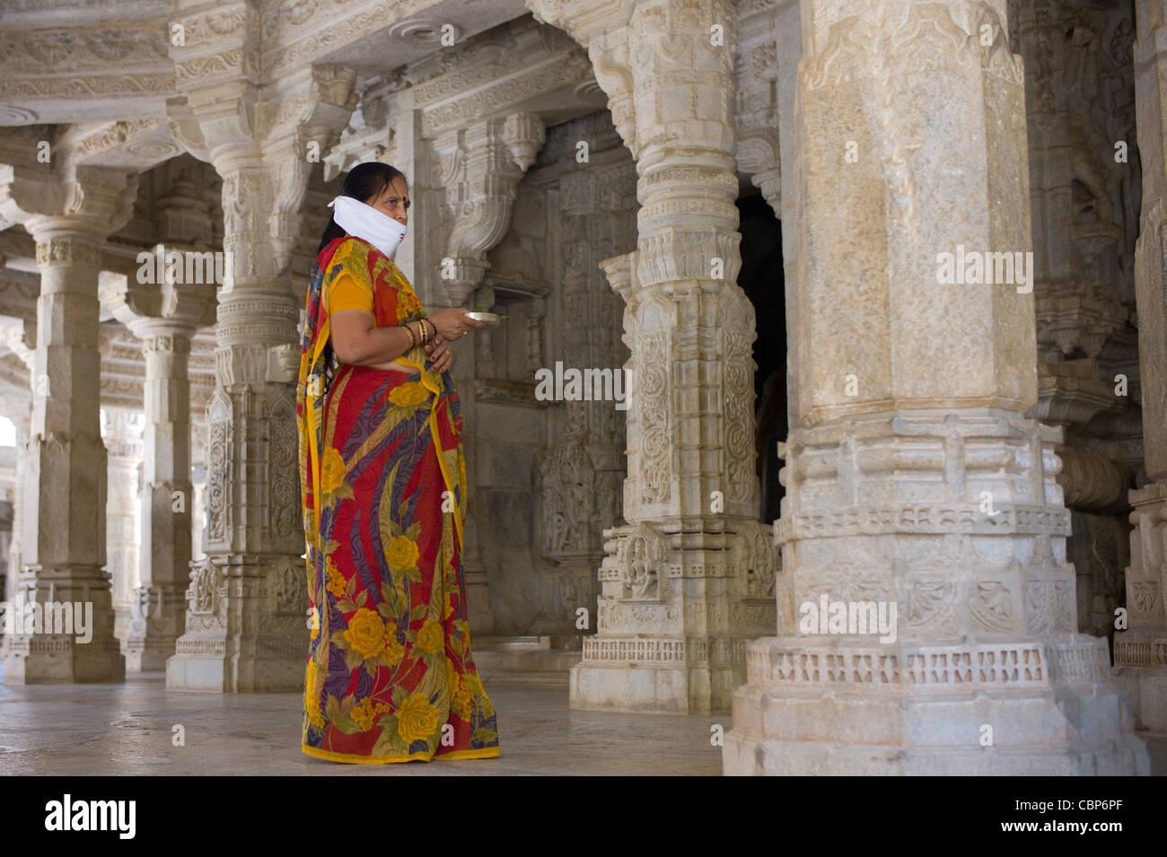 Jain pilgrim with traditional mask at The Ranakpur Jain Temple at Desuri Tehsil in Pali District, Rajasthan, India - Stock Image
