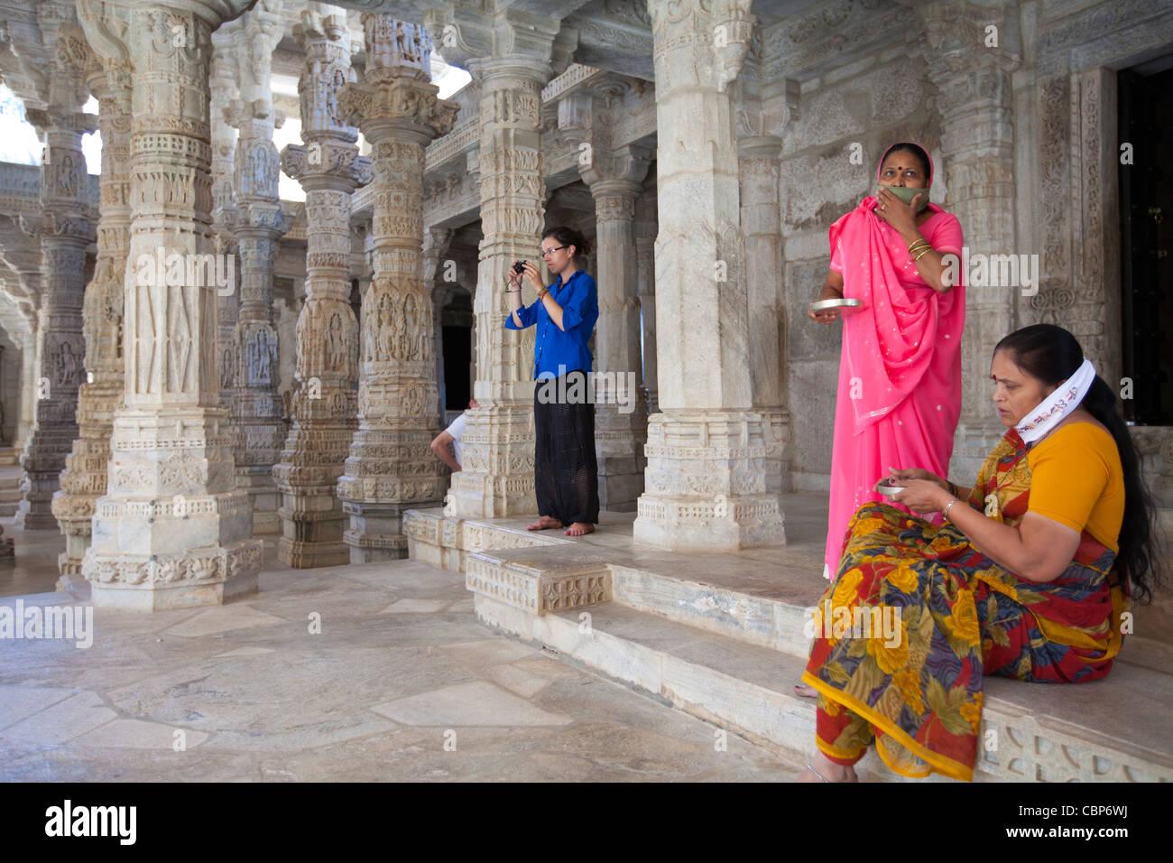 Jain pilgrims with traditional masks at The Ranakpur Jain Temple at Desuri Tehsil in Pali District, Rajasthan, India - Stock Image