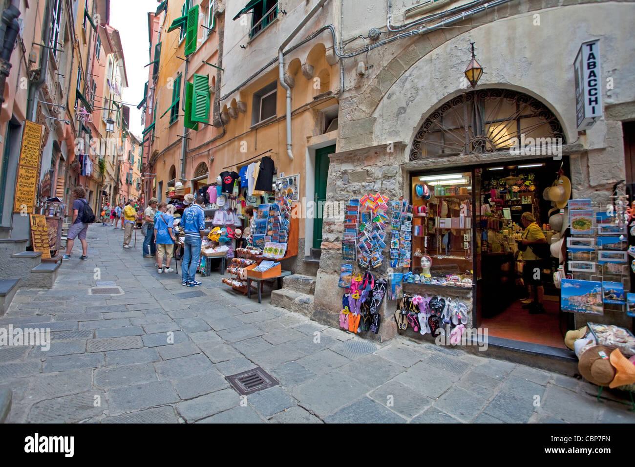 Shops and restaurants at narrow alley of fishing village Porto Venere, province La Spezia, Liguria di Levante, Italy, - Stock Image