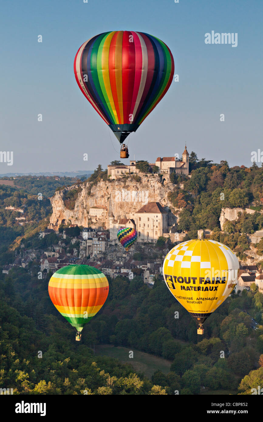 Hot air balloons (montgolfieres) at Rocamadour in the early morning. - Stock Image